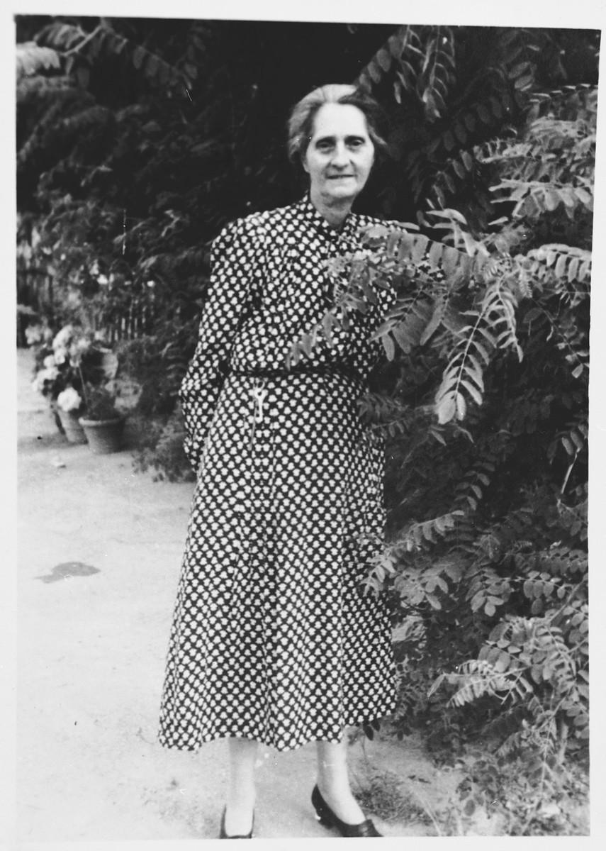 Photograph of Linda Abenaim (mother of Vanda Abenaim) taken in a garden only months before her death.