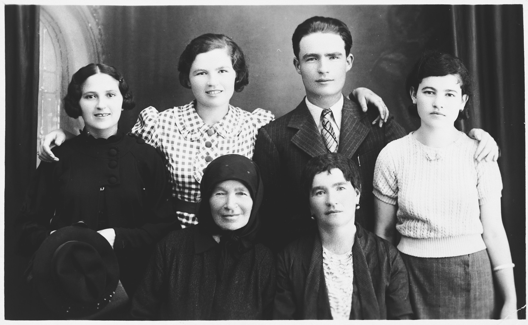 Portrait of the Leibowitz family.  Pictured are the isisters, cousins, grandmother, and mother of Chaya Leibowitz.