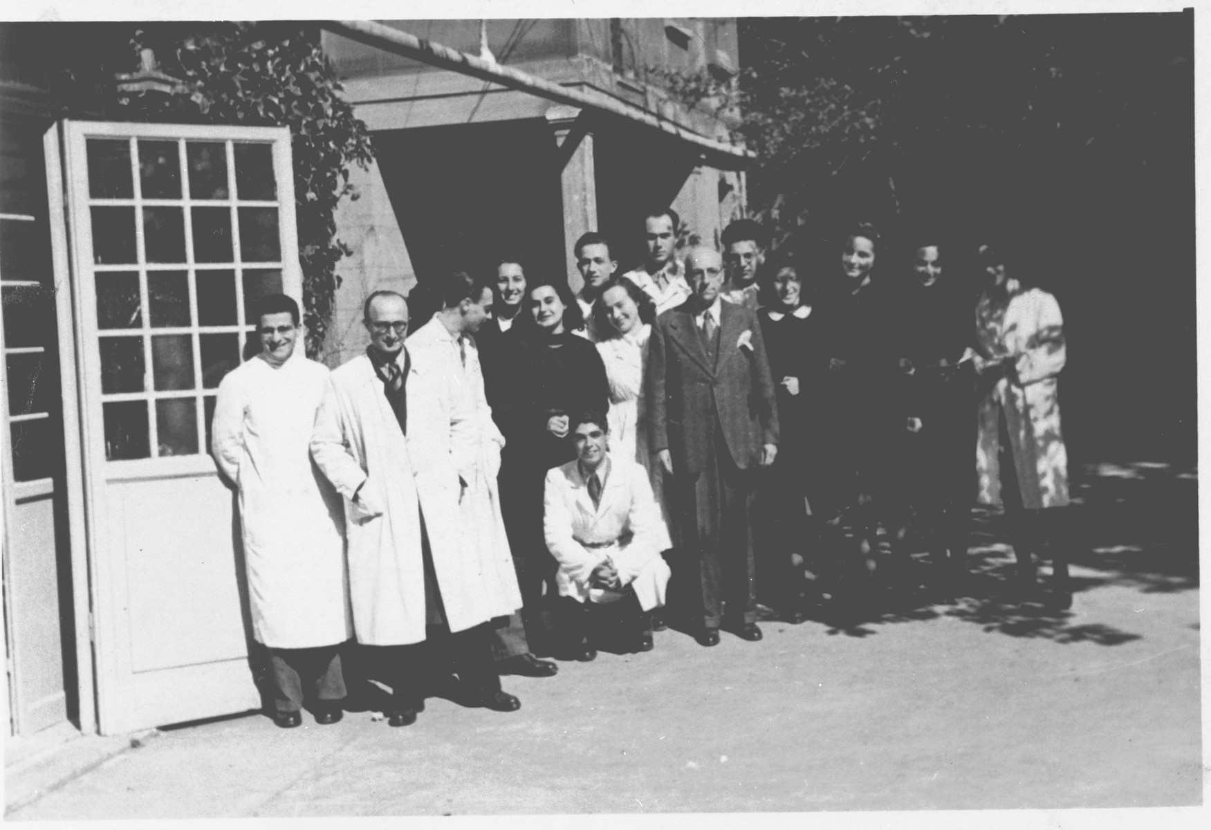 Students and faculty of the chemistry department of the Jewish high school in Milan stand in the school's courtyard.