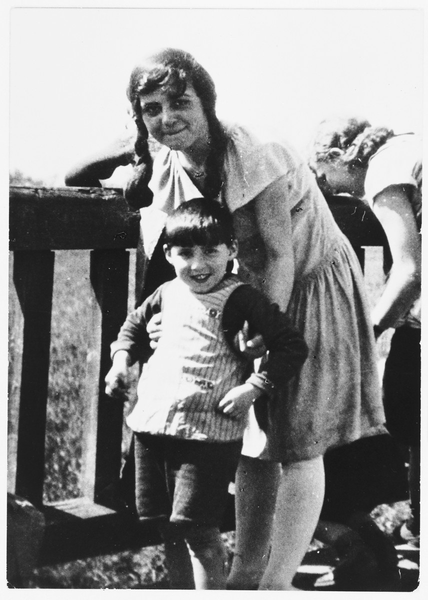 A young Jewish boy poses with his kindergarten teacher in Peine, Germany.  Pictured is Solly Perel with his teacher, Hanna.
