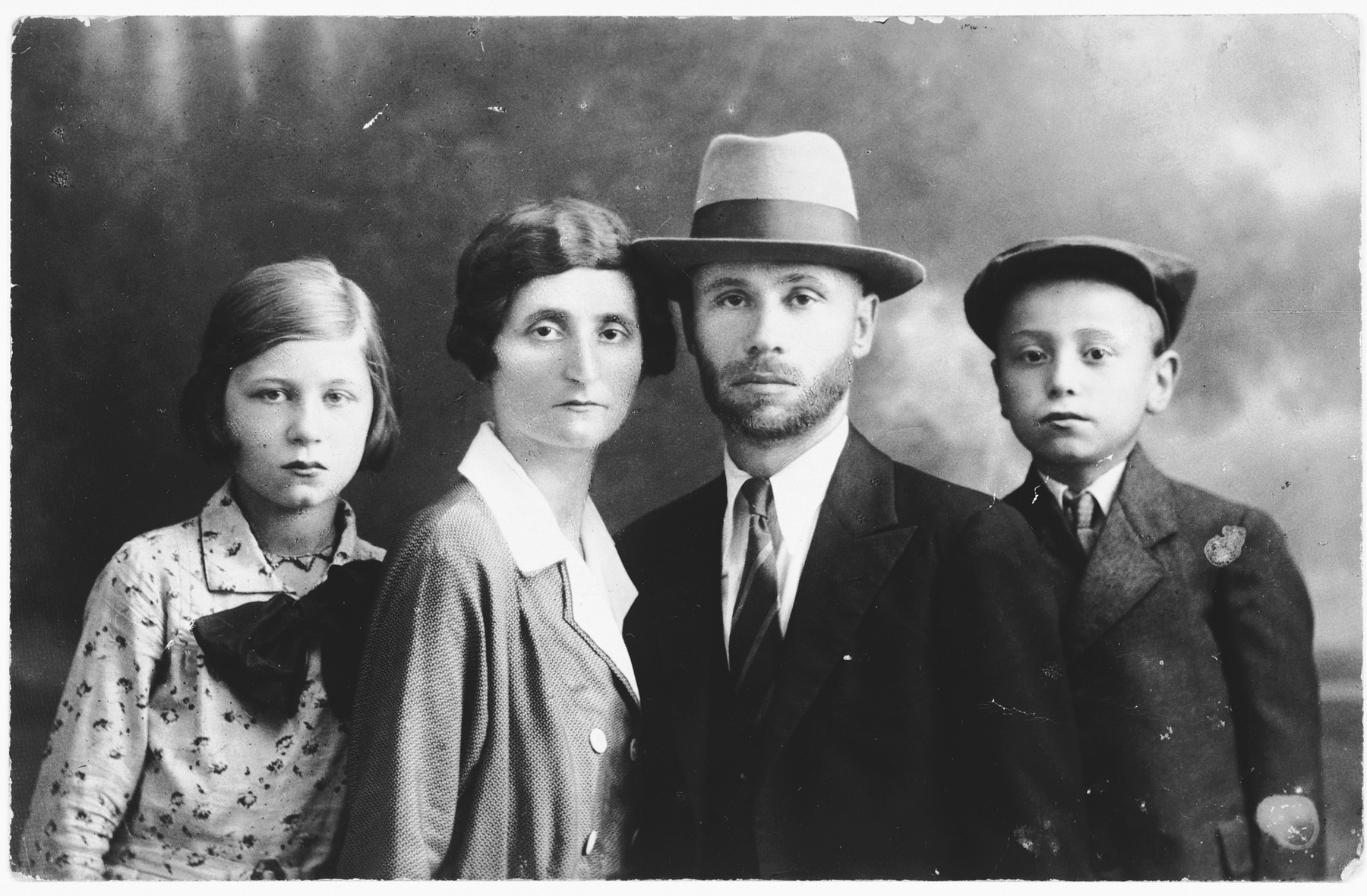 Portrait of the Fried family in Satu Mare, Romania.  Pictured are Samuel and Rose Fried and their two children, Gizella and Joseph.