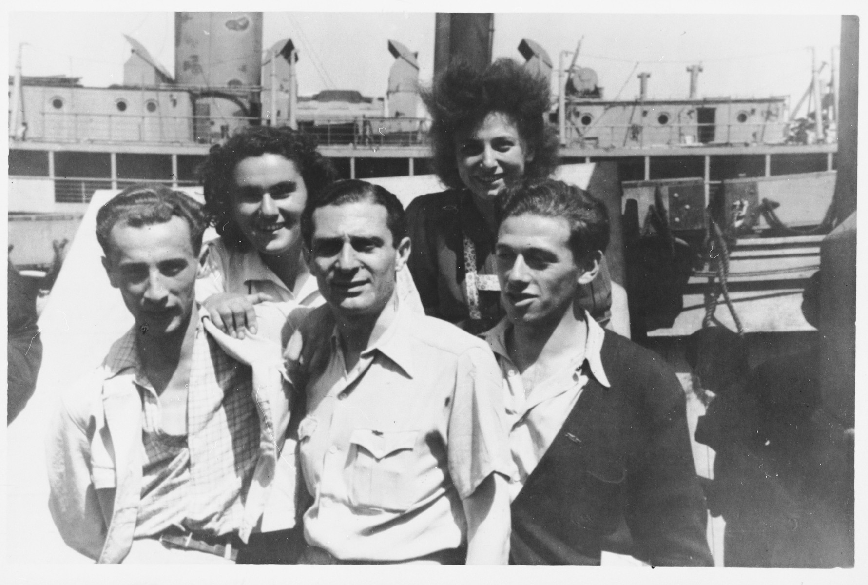 Group portrait of members of the Armée Juive French Jewish resistance at a reunion in Palestine in Kibbutz Sde Eliyahu.  Among those pictured is Simon Levitte, the head of Armée Juive (center).
