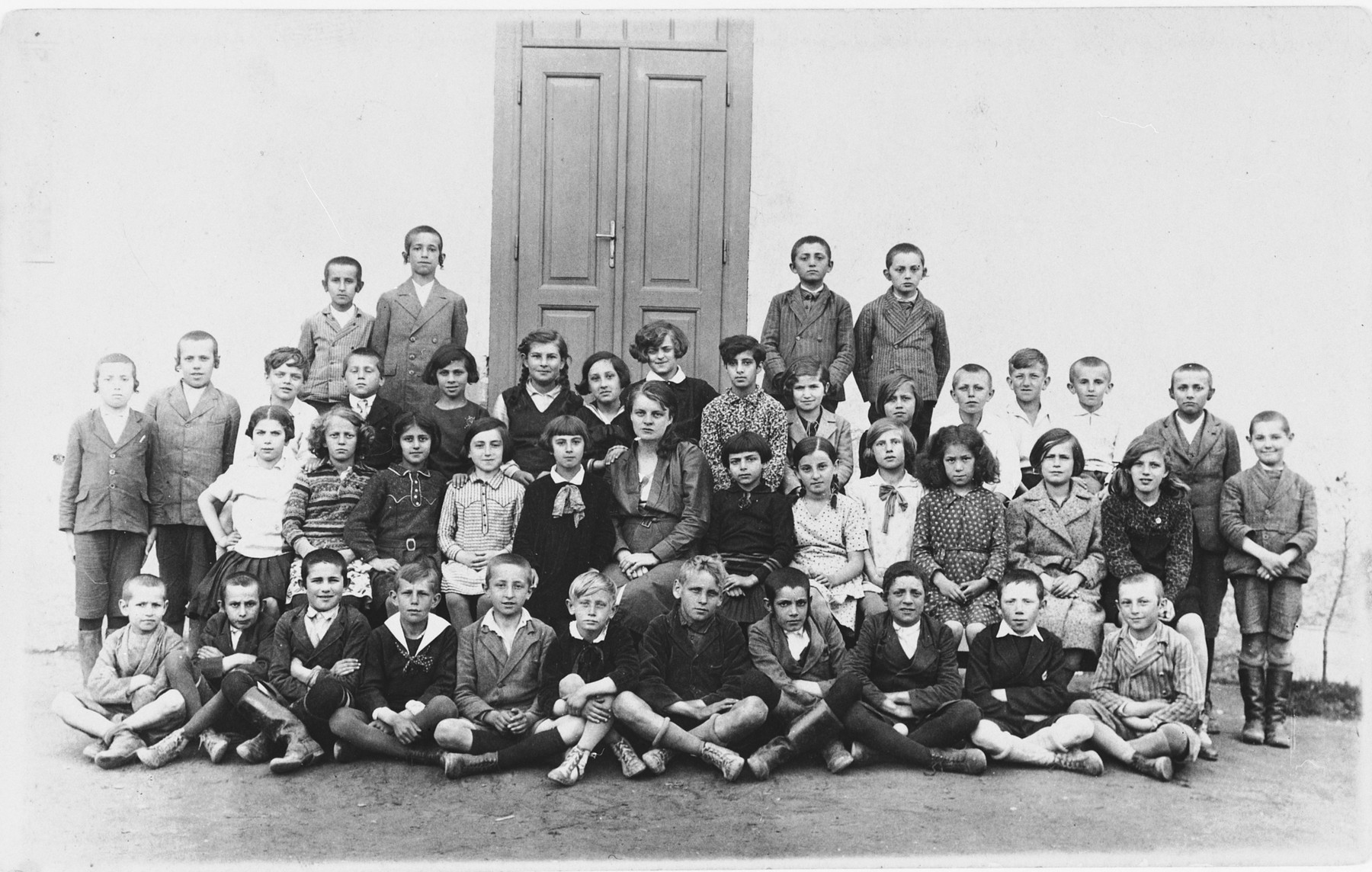 Group portrait of Jewish and non-Jewish children in a public school in Tacovo.  Among those pictured is Goldie Berger.