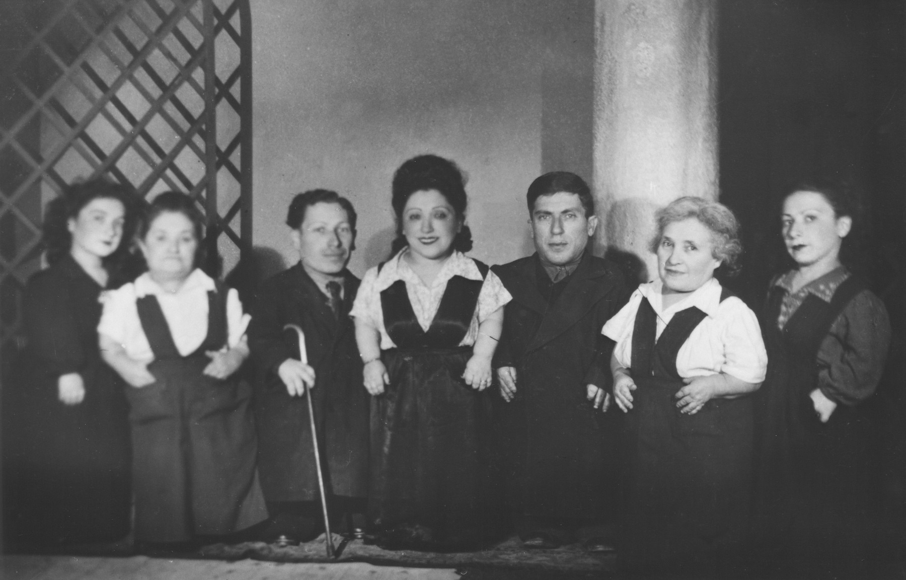 Group portrait of the Ovici family, a family of Jewish dwarf entertainers known as the Lilliput Troupe, who survived Auschwitz.  Pictured are Perla, Rozika, Abraham, Frieda, Micki, Francesca and Elizabeth Ovici.