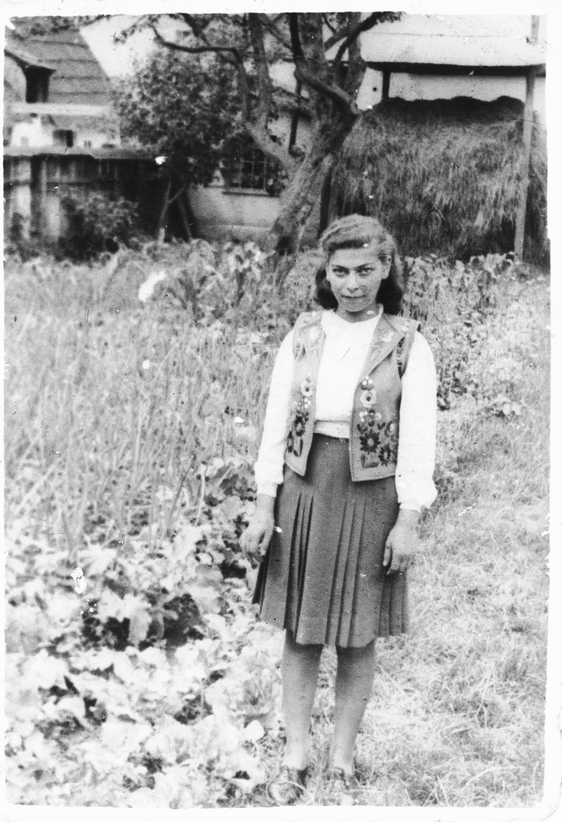 A Jewish teenager poses in the backyard of her home in Tacovo.  Pictured is Rachel Berger.