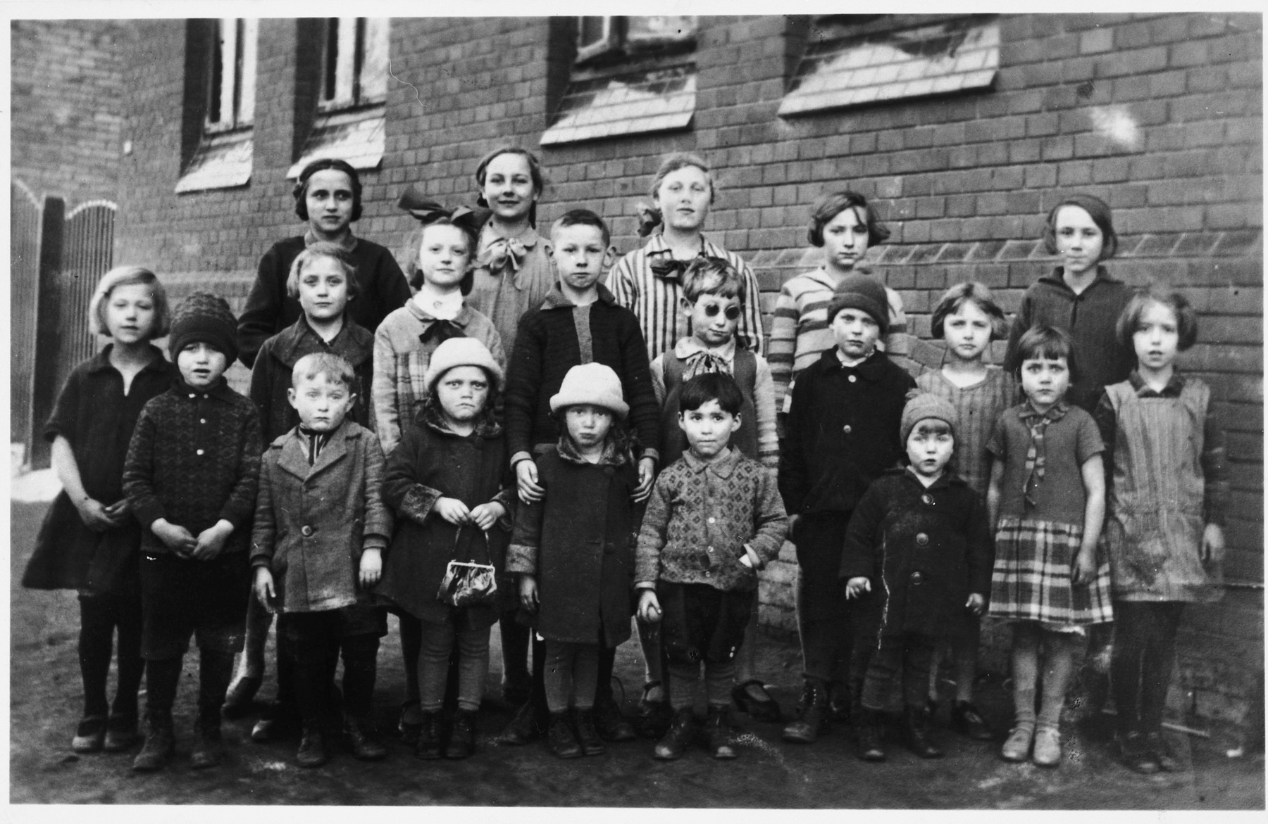 Group portrait of children in Peine, Germany.  Among those pictured is Solly Perel (front row, center).