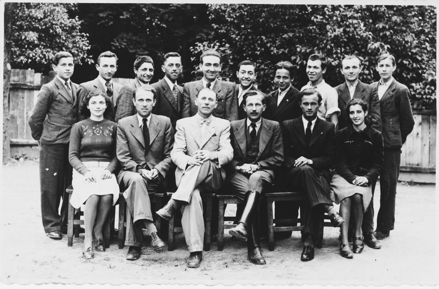 Group portrait of students and faculty at a vocational school in Tacovo.  Among those pictured is Goldie Berger (front row, left).