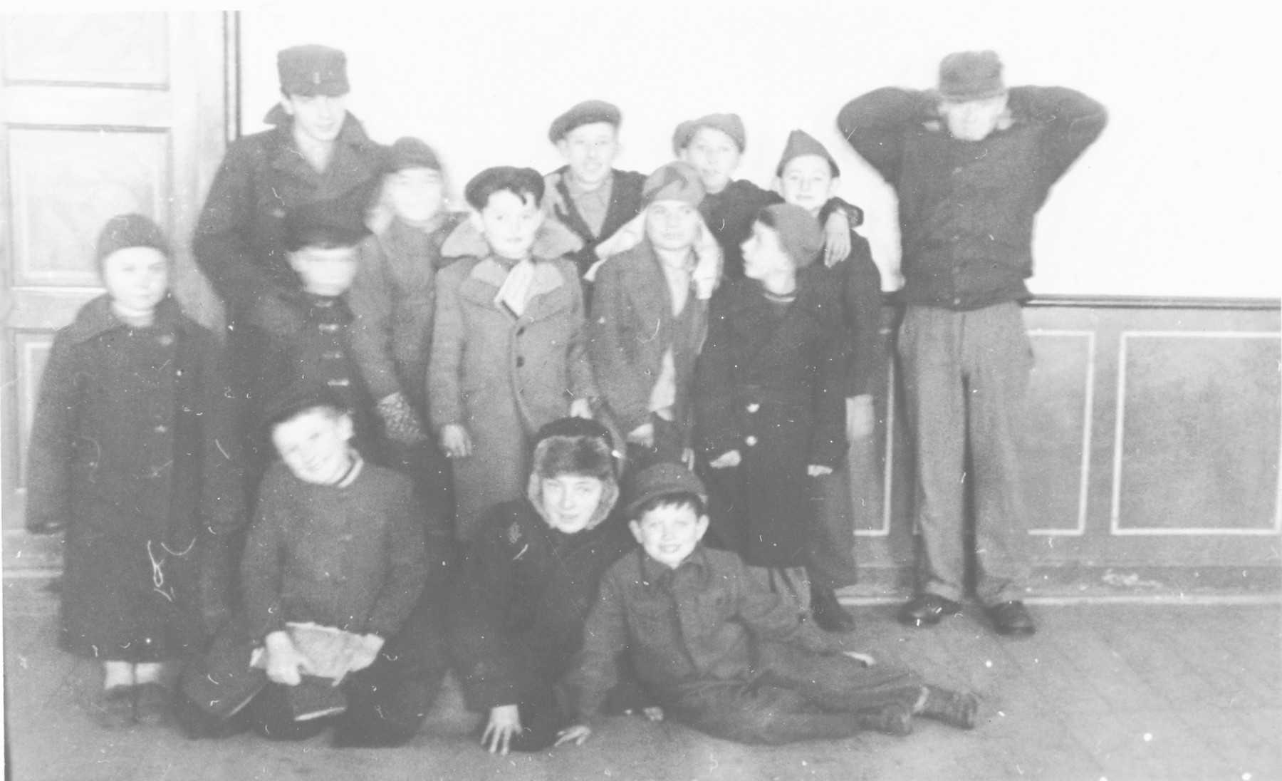 """Group portrait of school children in the Wetzlar displaced persons' camp.  Original caption reads, """"Jewish kids thrilled at posing for a picture."""""""