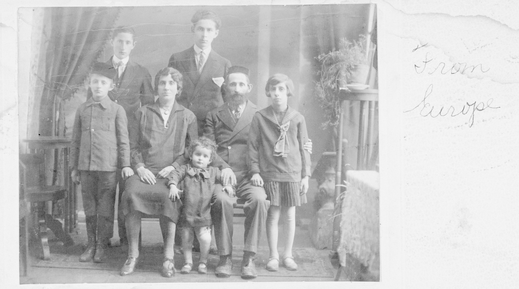 Studio portrait of Fraidl and Yehoshua Weinstein and their five children in prewar Poland.  Moshe Herschel is standing at the lower left.  The young child, Raizl, stands next to Yehoshua (Osias) Weinstein, and Miriam stands at the far right.  At the top right, stands Joseph, the oldest son.  None of the family members survived.