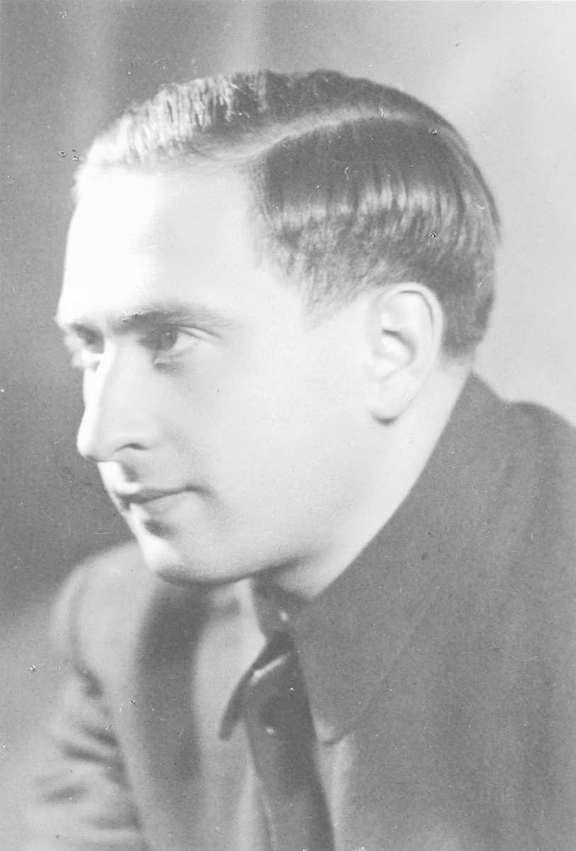 Leo Rosen sits for a studio portrait.  Leo was born in Kanczuga, Poland and hid the the village of Siedlce, Poland during the war.