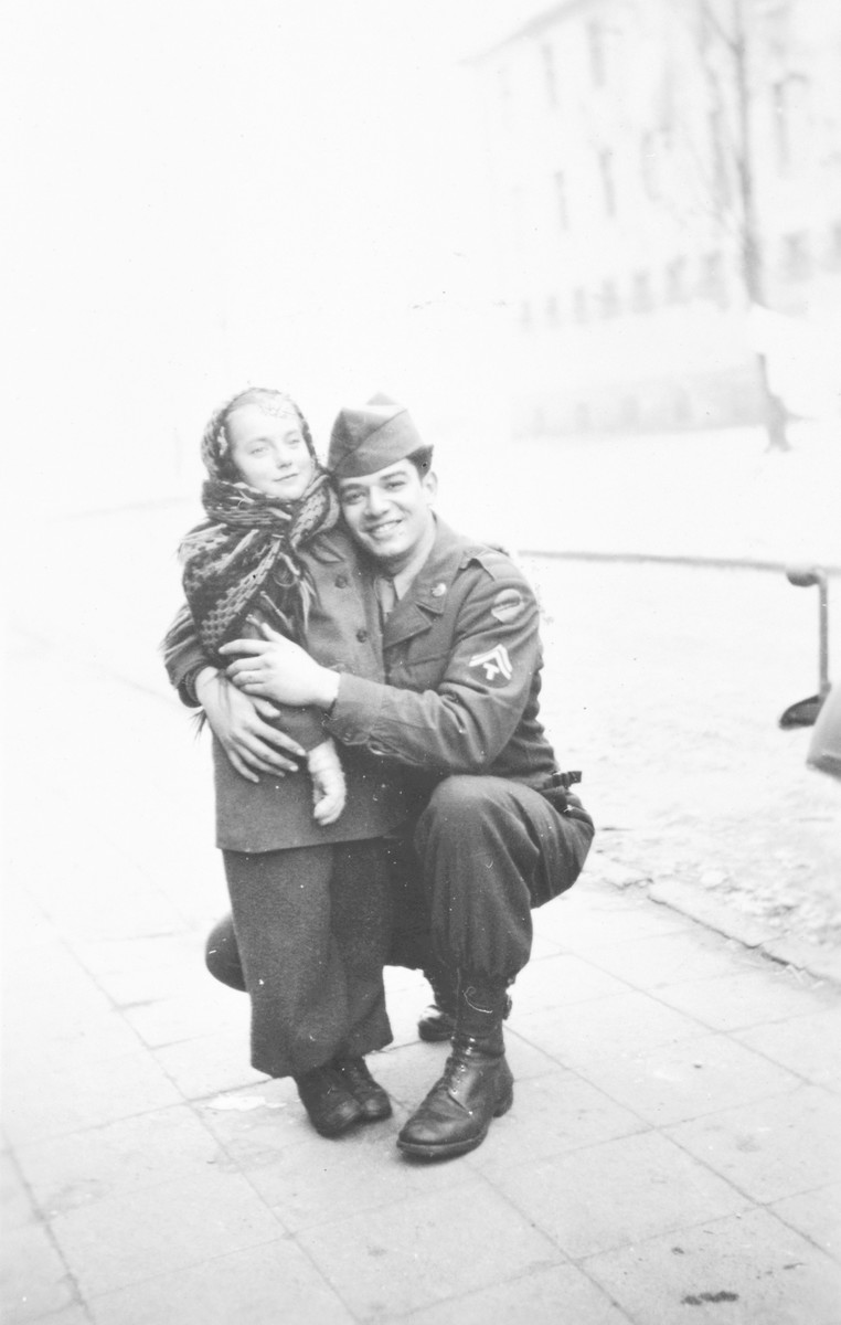 "A Jewish American serviceman, hugs Edith, a young girl inf the Wetzlar displaced persons' camp.  The original caption reads, ""Berman & Edith, 1-15-47."""