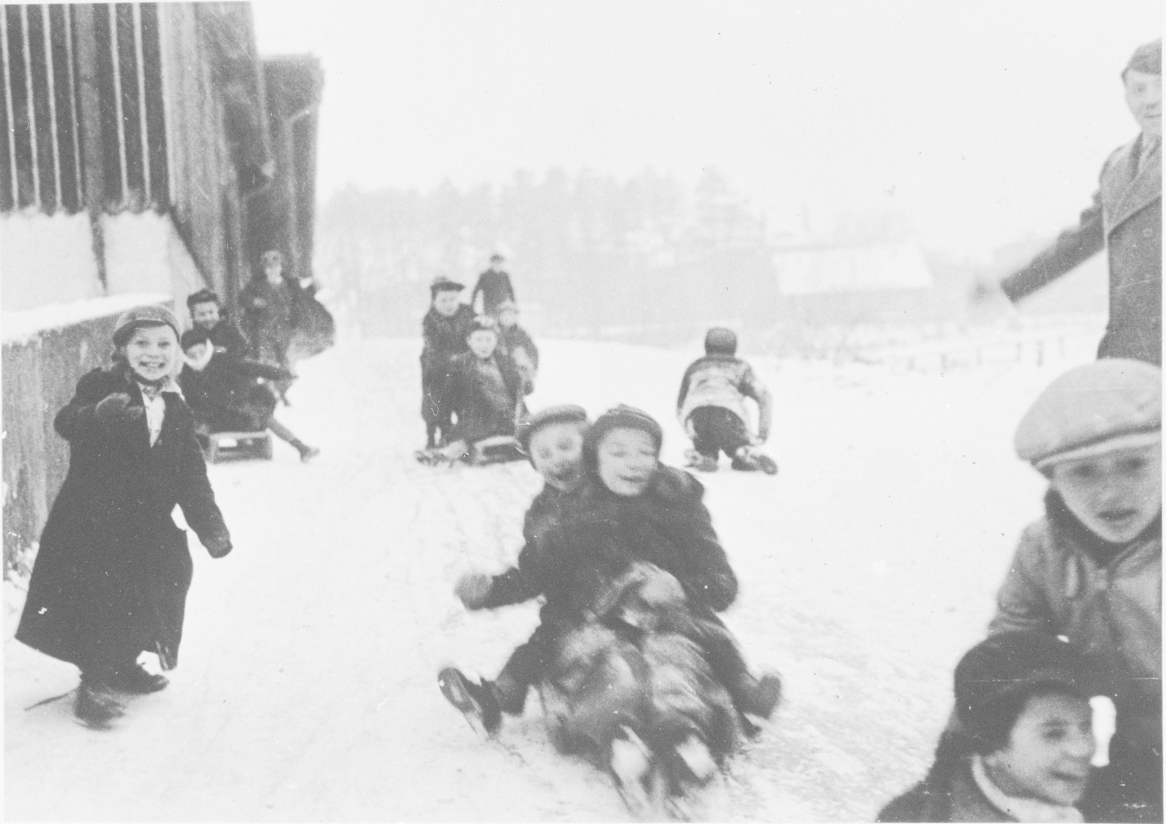 Children go sledding in the Ulm displaced persons' camp.