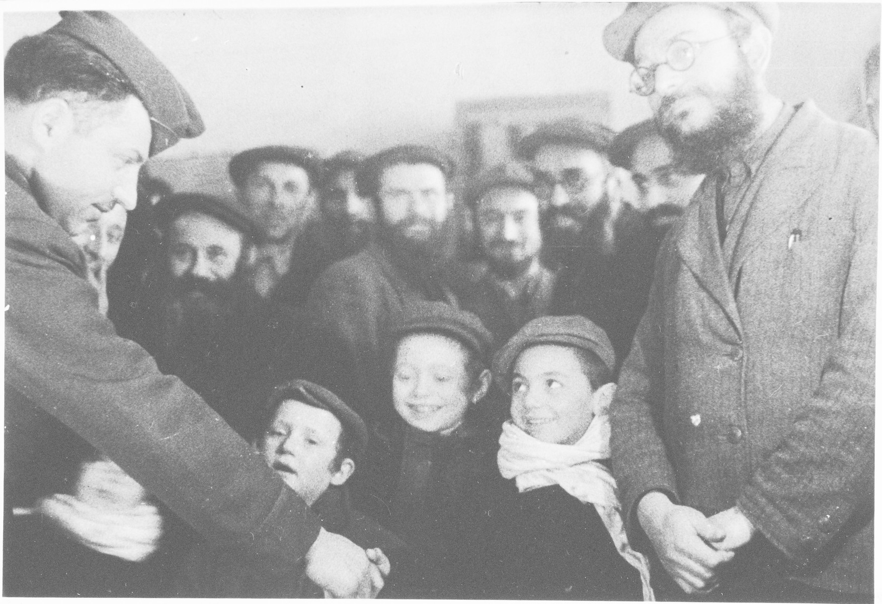 Rabbi Nathan Baruch, of the Vaad Hatzala, meets with young boys in the Pocking displaced persons' camp.