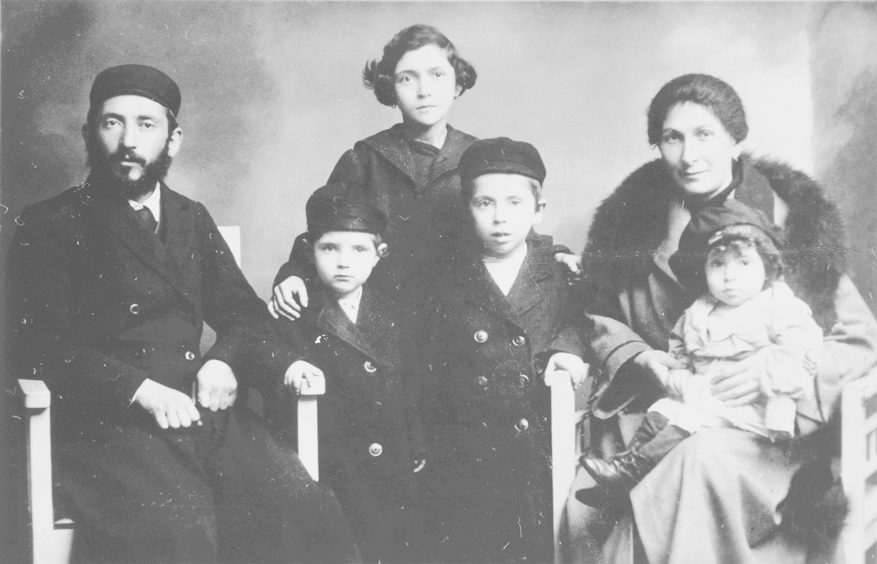 Family portrait of the Lieberman family in Pabianice.  Bernard Lieberman (now Lee) stands on the right of his father.