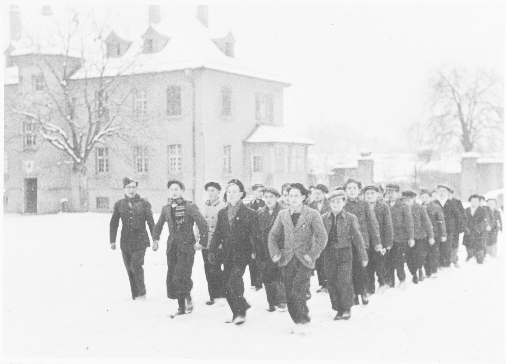 A group of religious boys line up in the snow in the Ulm displaced persons' camp.