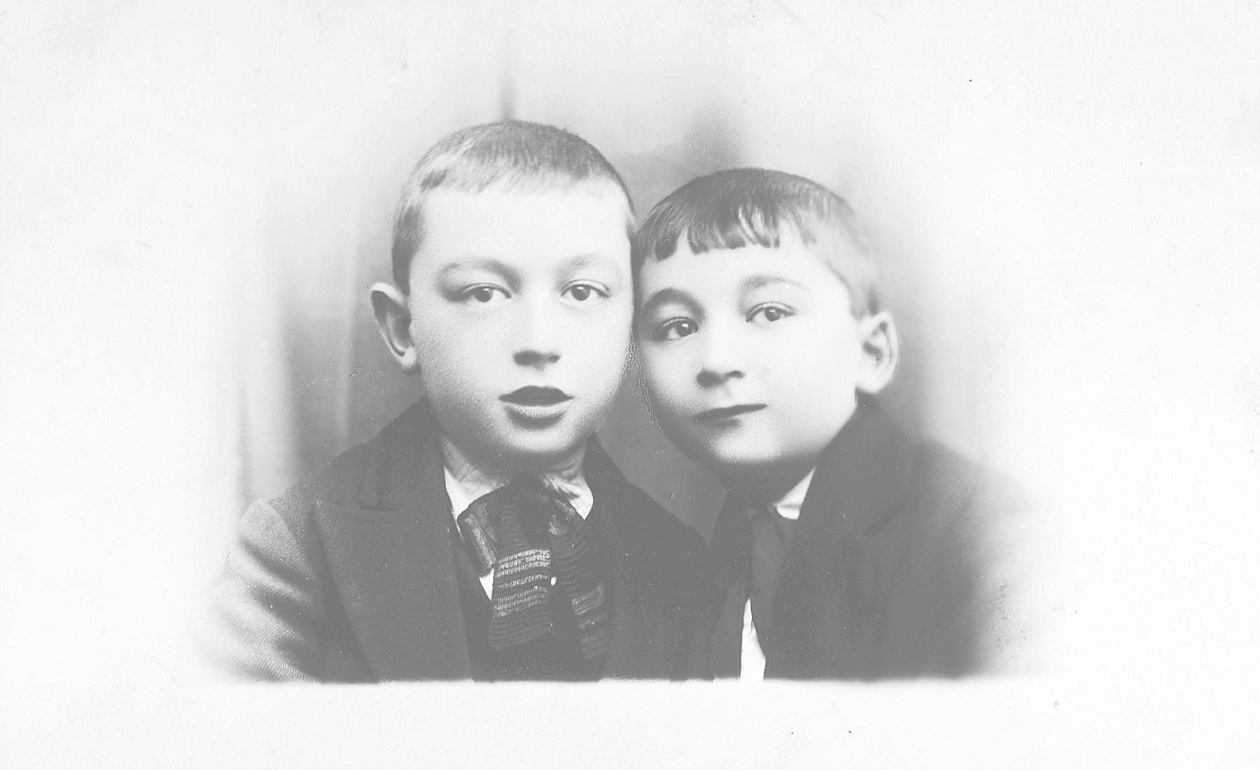 Studio portrait of Berel Leibl and Avraham Konopko taken on Purim day.