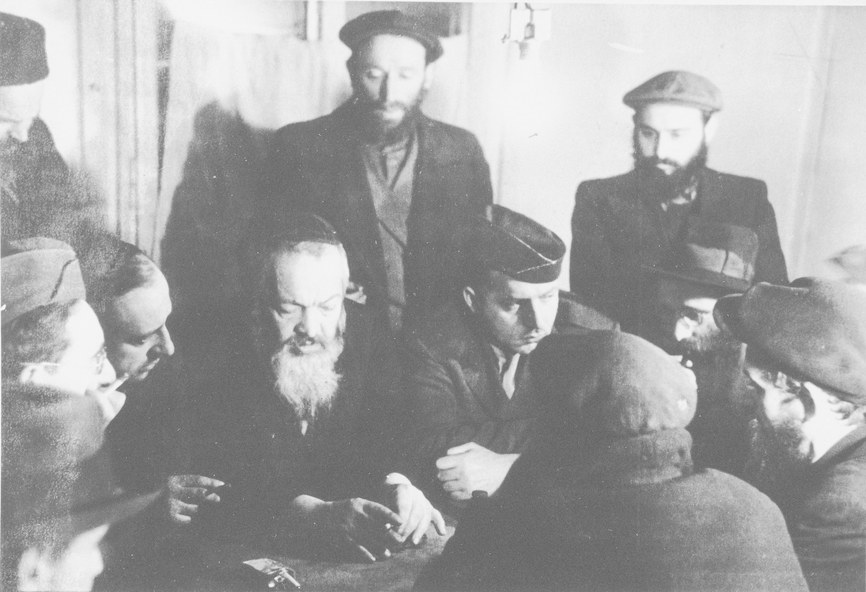 Rabbi Nathan Baruch meets with a group of religious men in the Pocking displaced persons' camp.