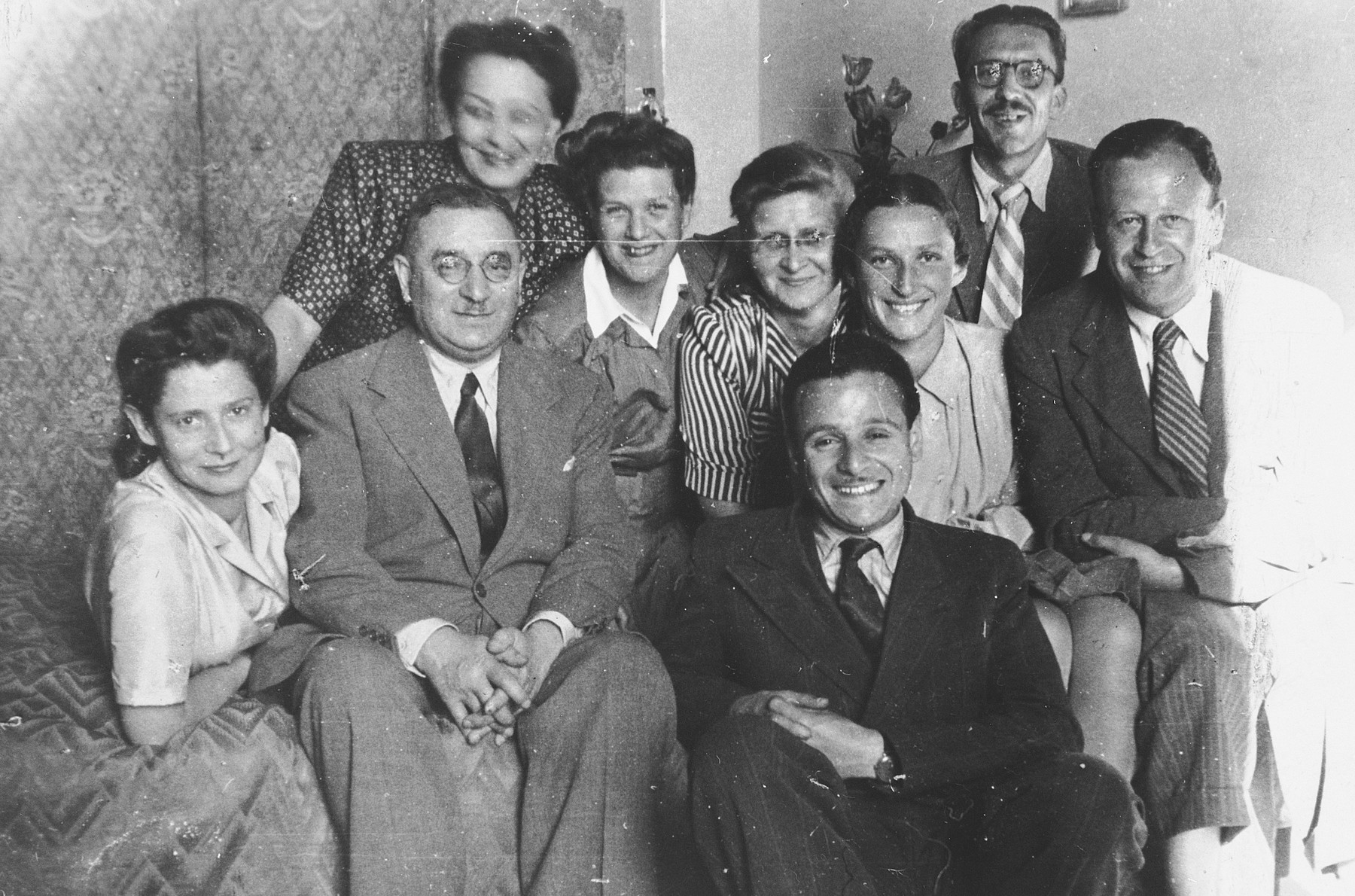 Group portrait of friends and relatives gathered in an apartment in Vilna.  Among those pictured are Dr. Elias Sedlis (front row, second from left), Alexander Sedlis (front row center), Dr. Abraham Wajnryb (far right) and Maryla Abramowicz.  Maryla Abramowicz was later recognized by Yad Vashem as Righteous Among the Nations.