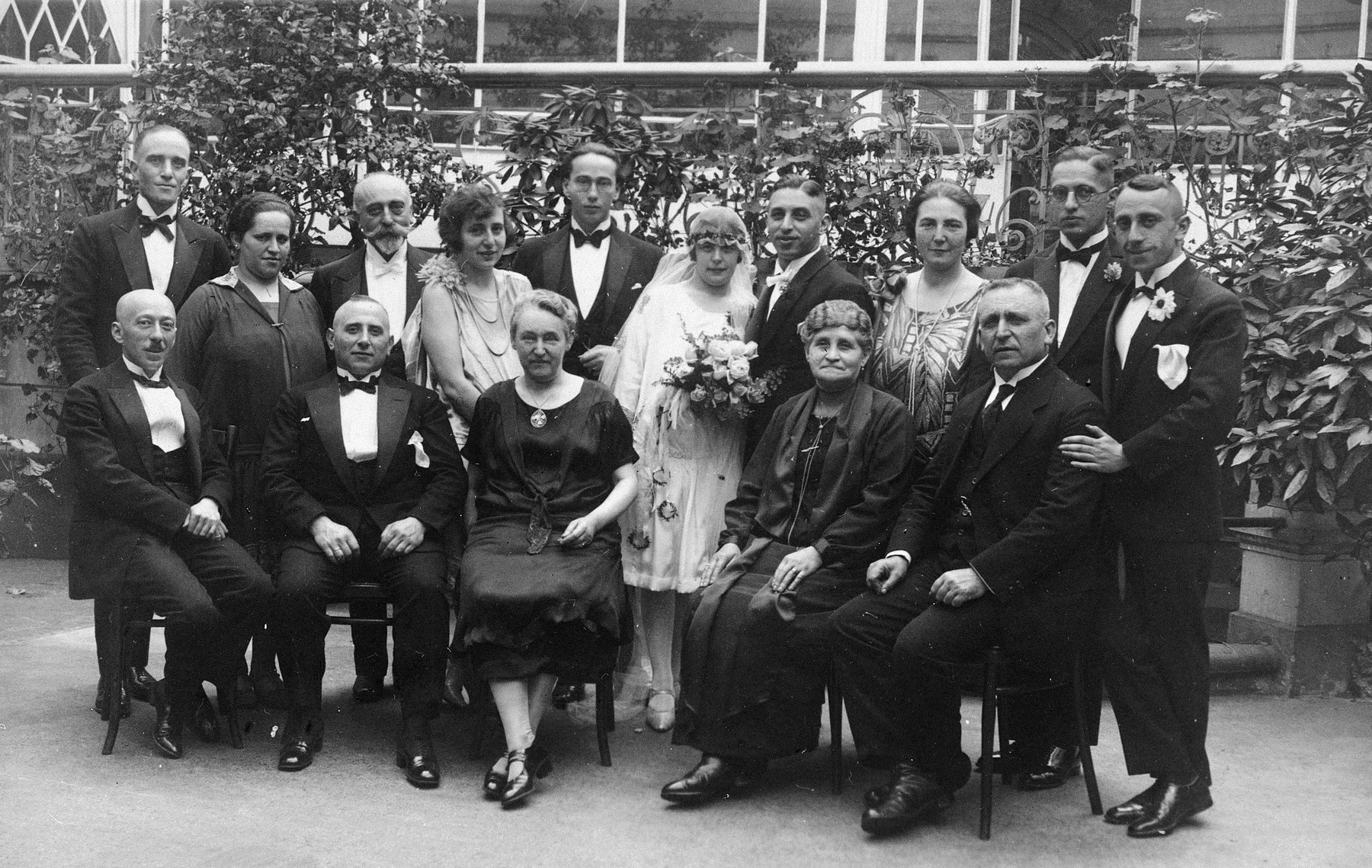A German-Jewish family gathers for a group portrait to celebrate the wedding of Hugo Pauly and Selma Herz.  Seated from left to right are Selma Herz's uncle, Solomon Kahn, Hugo Pauly's aunt (and the wife of Leopold Herz), Babette Herz Pauly (Hugo's mother), and Louis Herz.  Standing left to right: unidentified, Dora Pauly (Hugo's sister), Leopold Herz, an unidentified couple, Selma Herz, Hugo Pauly, Rose Kahn (Selma's older sister), Theodore Pauly (Hugo's oldest brother) and Alfred Herz.