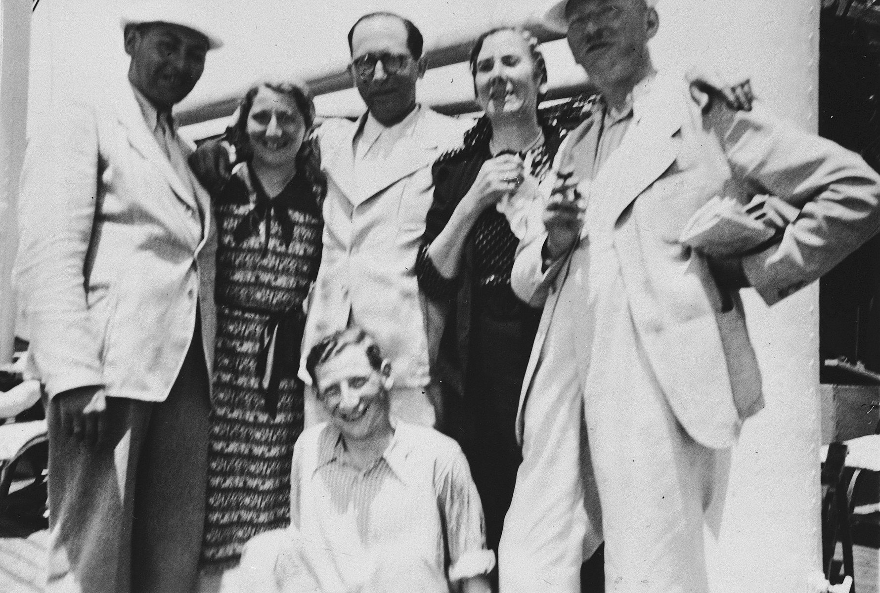 Jewish refugees from Breslau pose on the deck of the St. Louis.  Seated in front is Ernst Meyer.  Standing left to right are Kurt Marcus, Ilse Marcus, a friend from Breslau, Elfriede Meyer, and Berthold Meyer.