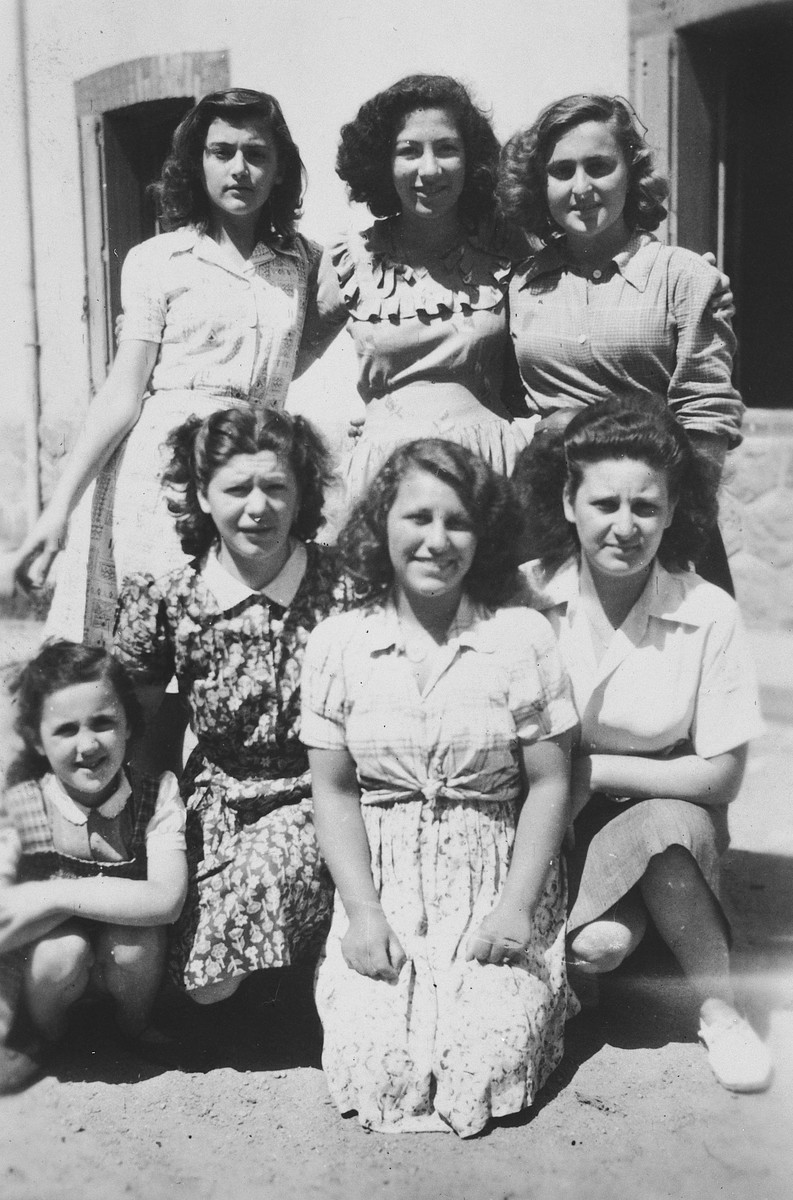 Group portrait of seven Jewish girls and teenagers in a postwar children's home in Feneyrols, France.