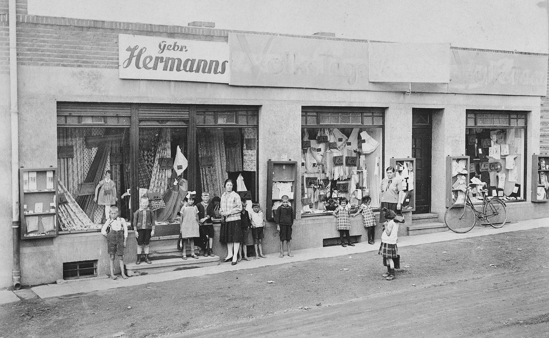 Members of the Hermanns family pose outside their dry goods store in Moenchengladbach, Germany.