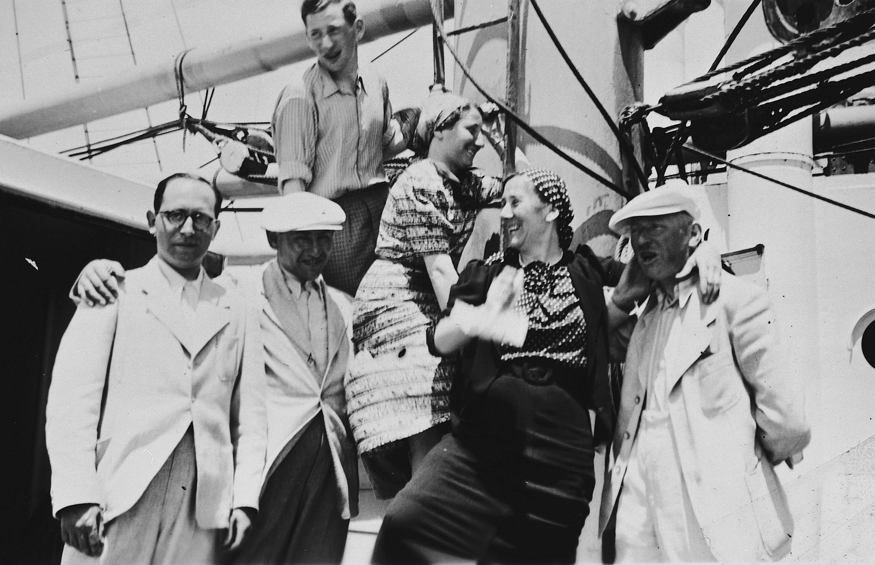 Jewish refugees from Breslau pose on the deck of the St. Louis.  From left to right are a friend from Breslau, Kurt Marcus, Ernst Meyer, Ilse Marcus, Elfriede Meyer and Berthold Meyer.
