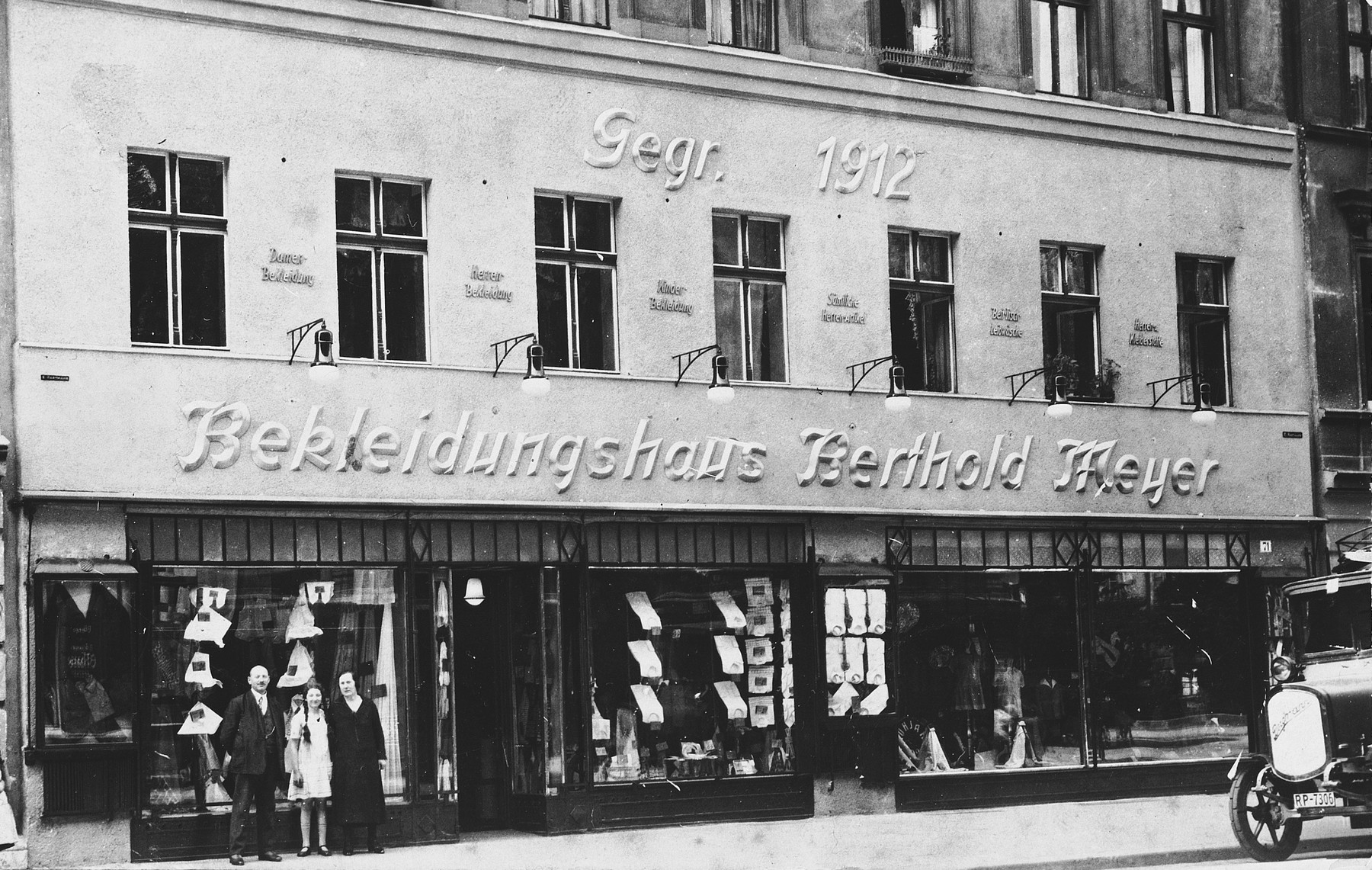The Meyer family stands in front of Berthold Meyer's clothing store in Breslau Germany.