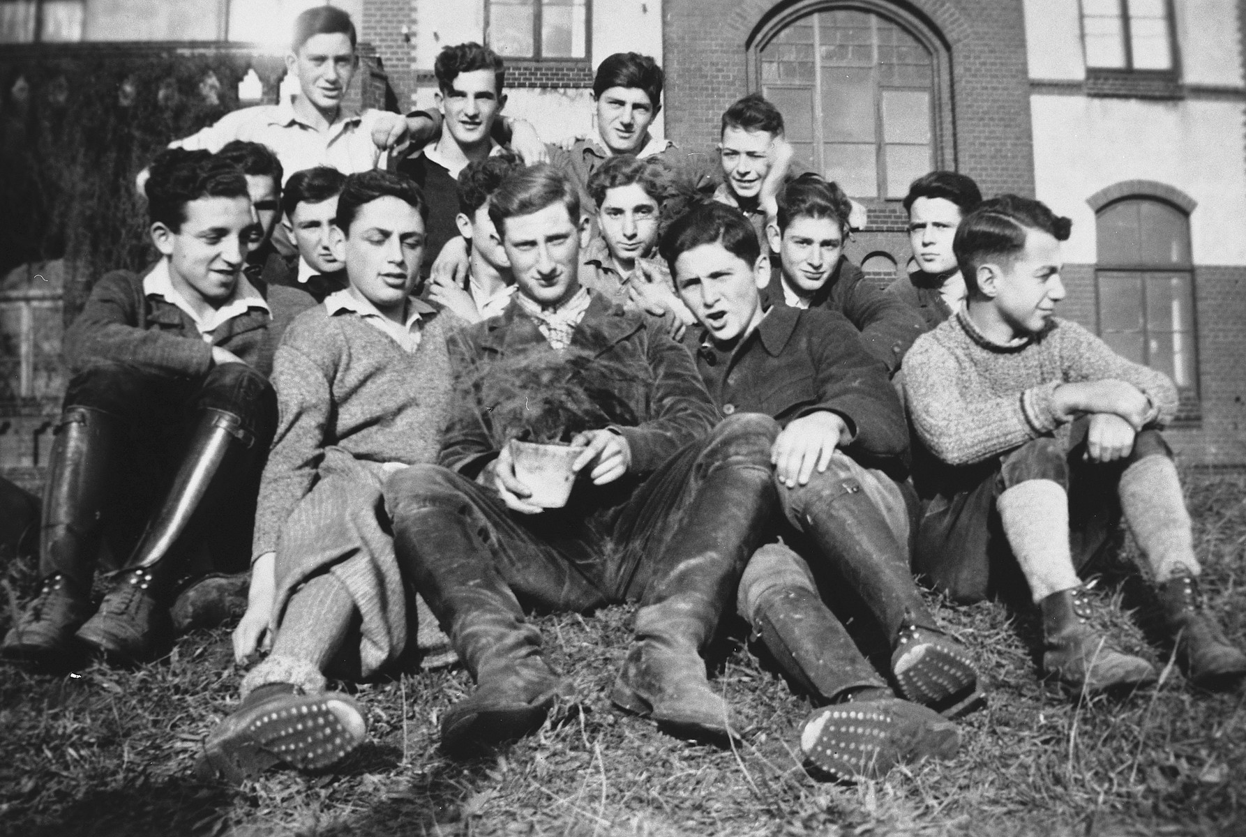 Group portrait of Jewish-German youth in an agricultural training farm outside of Berlin.  Among those pictured is Ernst Meyer in the front center.