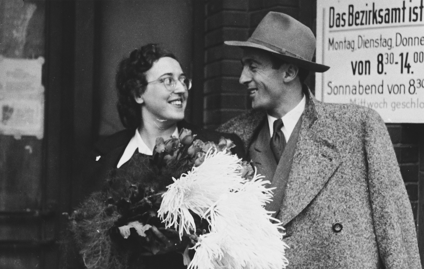 A Jewish couple poses outside a government office on their wedding day.  The bride, Lotte Schuefftan (b. Germany), was a cousin of the donor and a nurse in the Berlin Jewish Hospital.  The groom is Srulik (Sam) Brod (b. Poland).