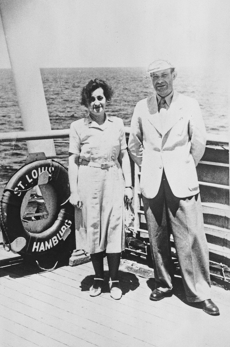 A Jewish couple poses next to a life preserver on the deck of the MS St. Louis one day after it left Hamburg harbor.  Pictured are Richard and Betty Blum.