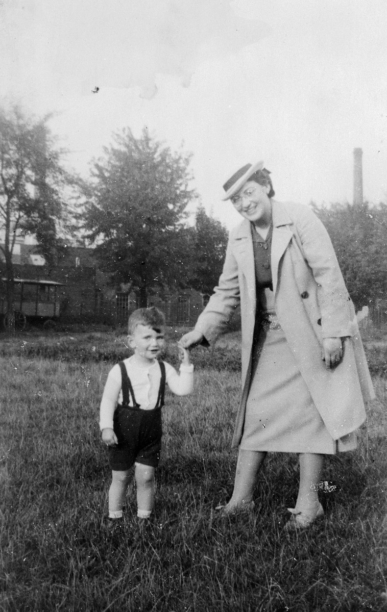 A German-Jewish mother takes her son for a walk through a grassy field.  Pictured are an aunt and cousin of the donor, Kurt Pauly.