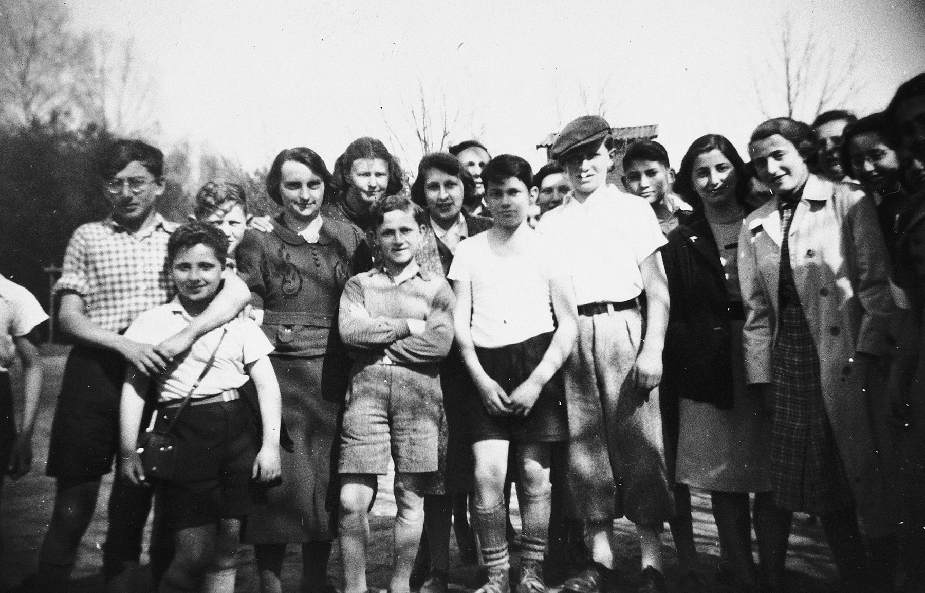 Group portrait of German-Jewish children staying at the Ons Boschhious children's home in Driebergen before going on a trip to see a soccer game in Soesterberg, Holland.