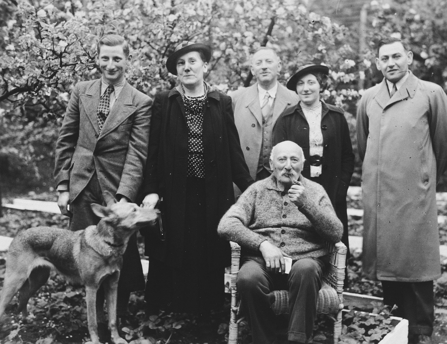 A German-Jewish family poses outdoors for a family portrait with their dog.  Standing from left to right are Ernst Meyer, Elfriede Meyer, Berthold Meyer, Ilse Meyer Marcus and Kurt Marcus.
