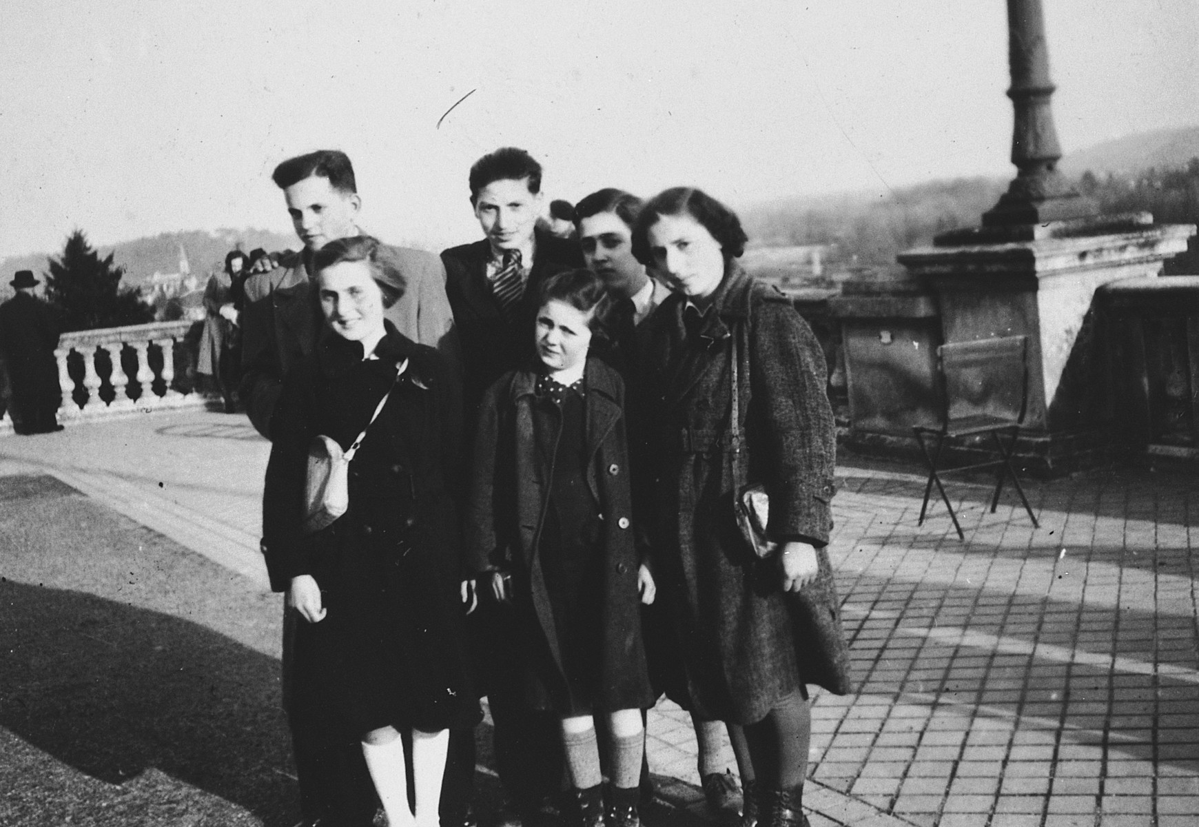 Children from La Guette children's home pose for a group portrait in a plaza in Pau while on route to visit their parents in the Gurs concentration camp.  Among those pictured is Ruth Strauss.