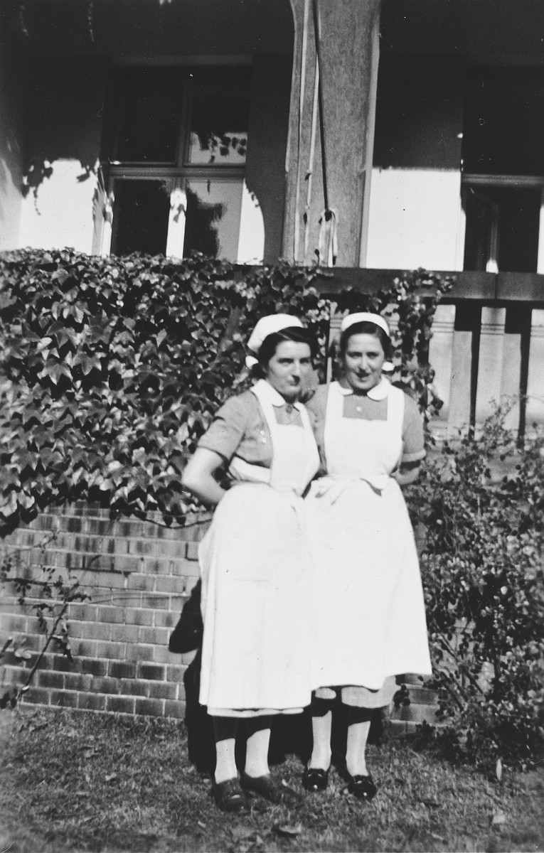 Two nurses in uniform pose outside the Berlin Jewish hospital.   Among those pictured is Lotte Schuefftan, a cousin of the donor.