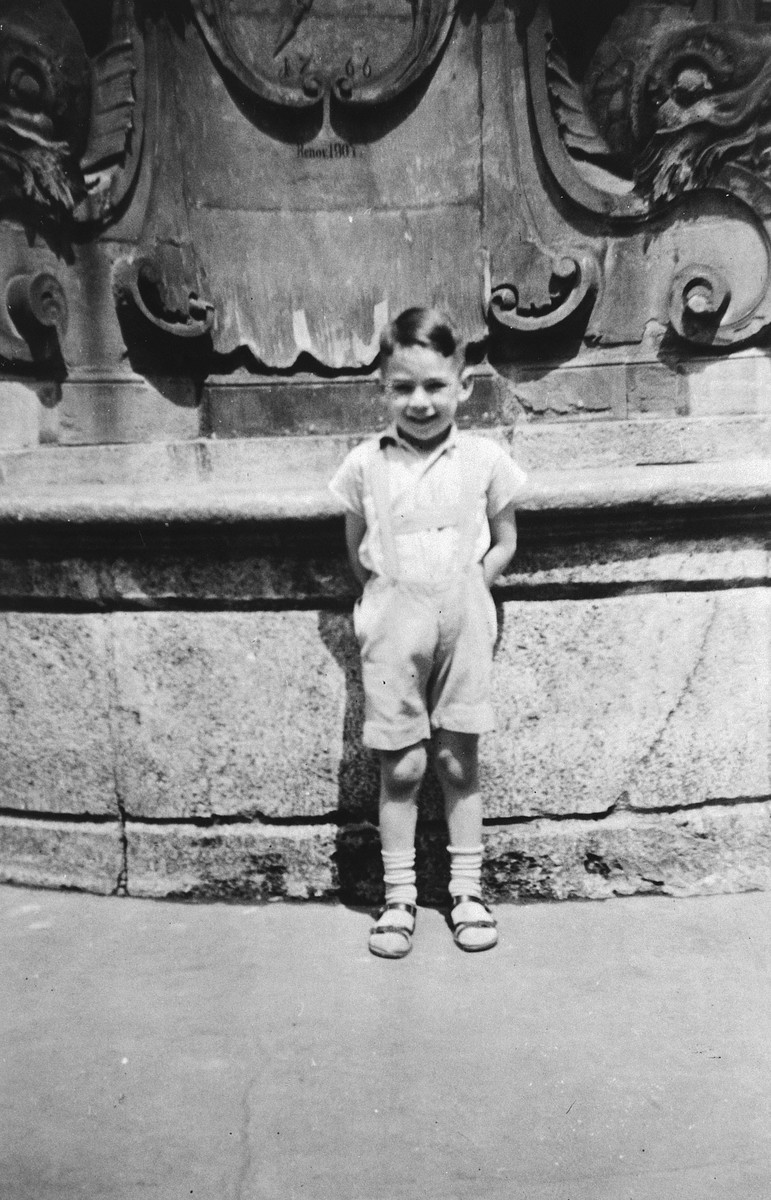 A young German-Jewish child poses by a large fountain in Wuerzberg.  Pictured is Kurt Pauly.