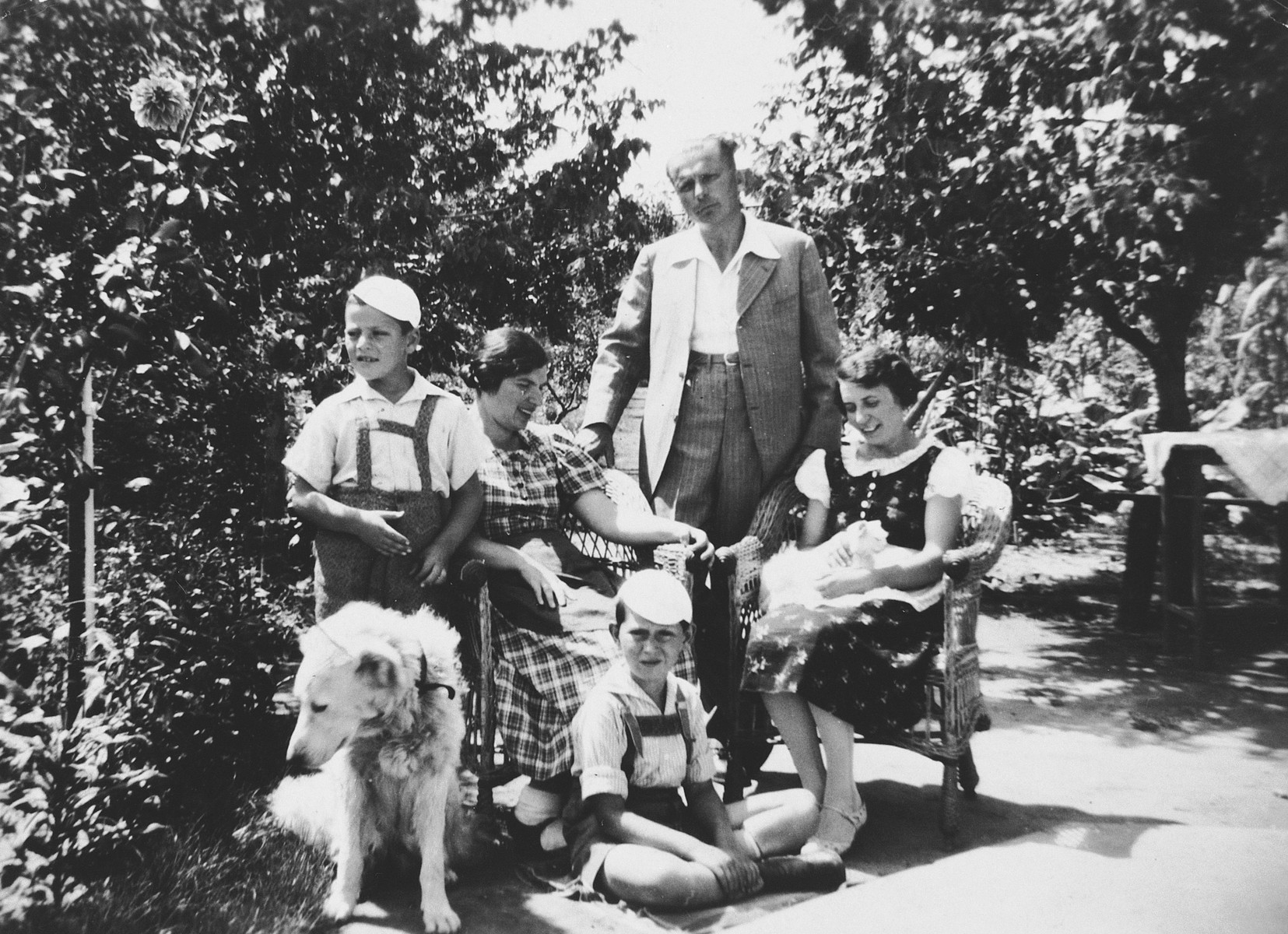 The Mayer family poses for a family portrait with their dog while vacationing in a rented cottage in the Hungarian countryside.