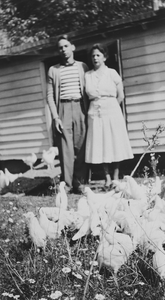 German-Jewish immigrants to the United States pose outside their home on a chicken farm in Vineland, NJ.  Pictured are Selma Herz Pauly and her son, Kurt.