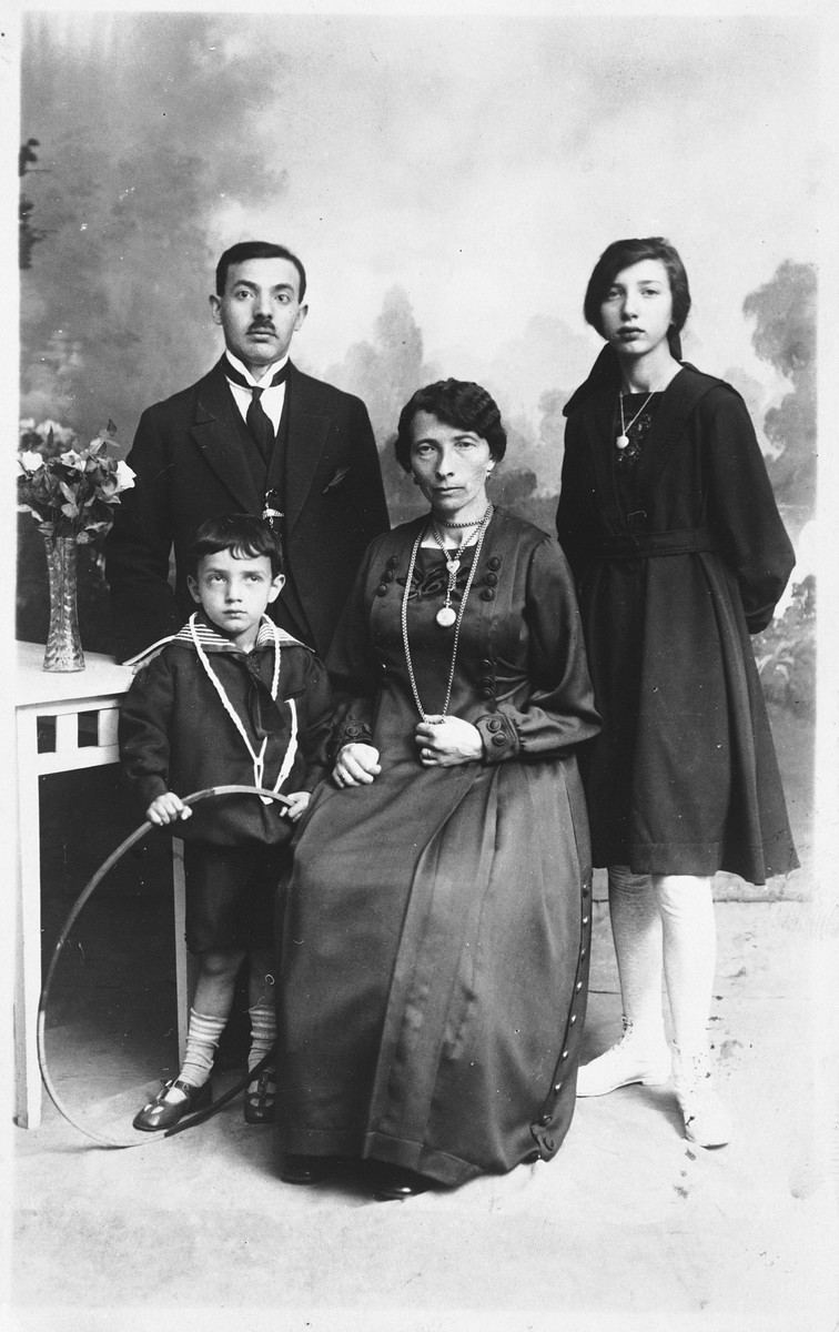 Studio portrait of a Jewish family in Copenhagen.  Pictured are Nachmendel and Esther Malka Lystmann and their two children.  The daughter is names Sara Bela.  The Lystmanns were cousins of the Diament family.