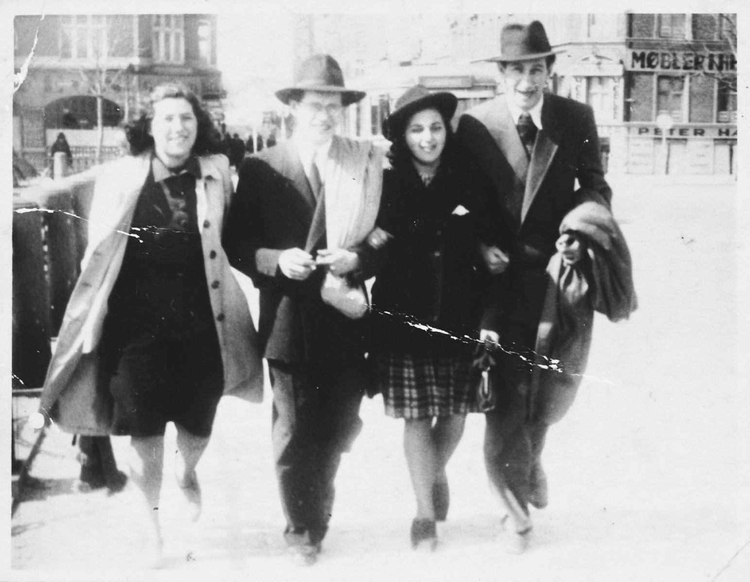 Four young Jewish men and women walk along the Fredriksgade in downtown Copenhagen during the German occupation.  Pictured from left to right are: Esther Diament, David Nussbaum, Leila Altschuler, and Jac. Kransnik.