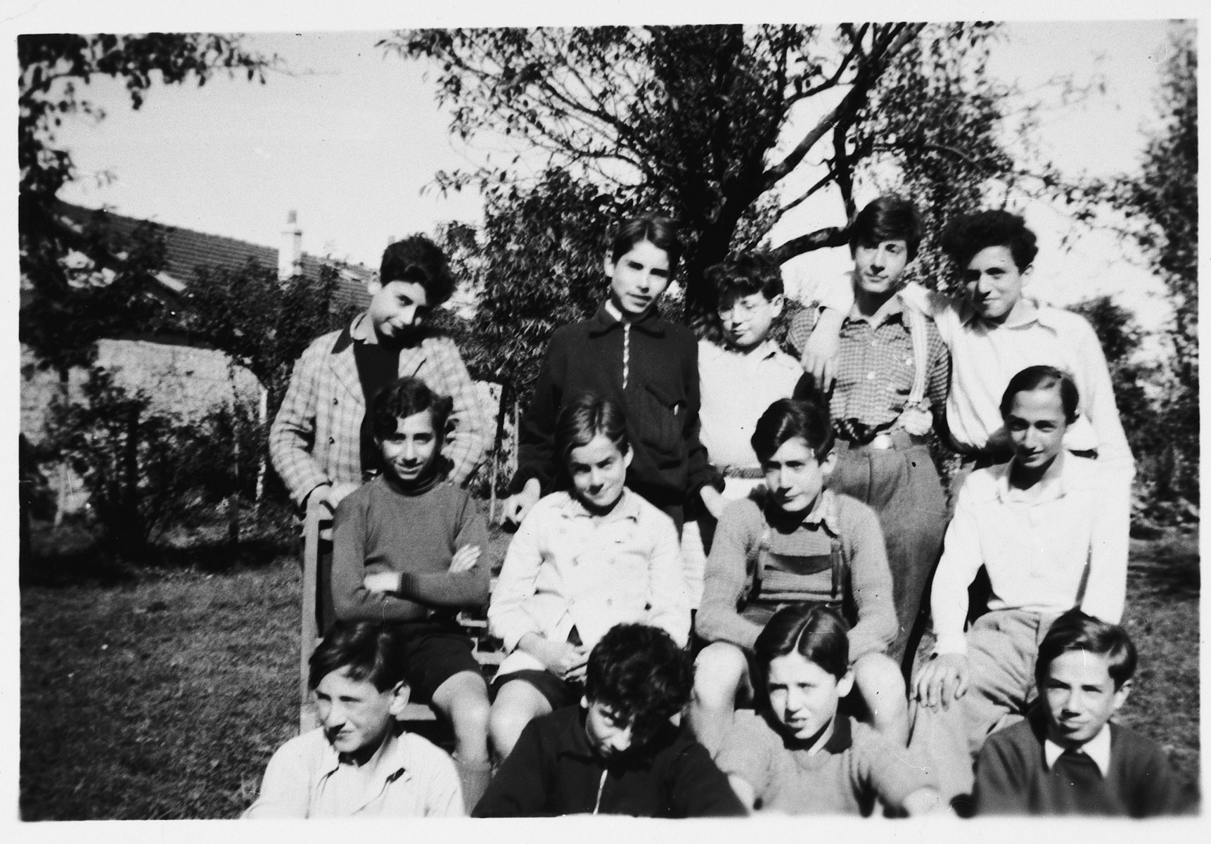 Group portrait of Jewish refugee boys who came to France on a Kindertransport from Germany.  Pictured from left to right are: front row: A. Kaczinsky, E. Goldfarb, S. Lewy, G. Rosenzweig; middle row:  H. Mastbaum, W. Blumenreich, J. Alter and G. Blatt; top row: B. Warschauer, W. Herzig, E. Heysemann, C. Zimmermann and J. Kollender.