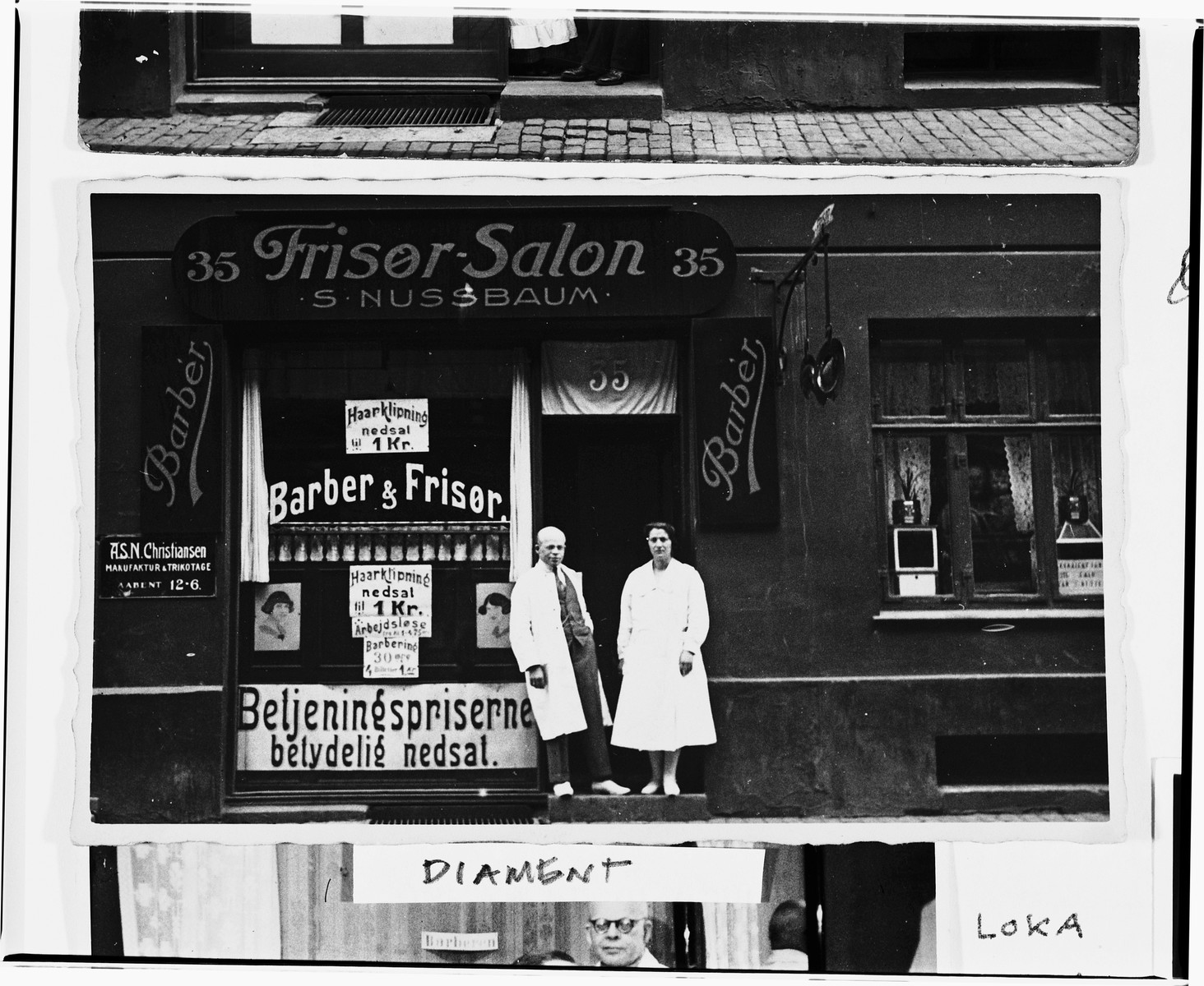 A Jewish couple poses in the doorway of their newly renovated barbershop located on the Ochenschlagergade in Copenhagen.  Pictured are Saul and Chane Nussbaum, who live in the same building.