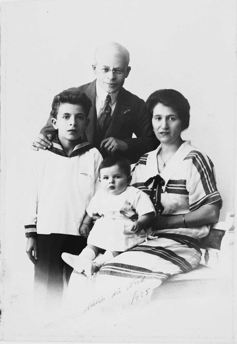 Studio portrait of a Jewish family in Copenhagen.  Pictured clockwise from the top are Saul, Chane, David, and Leon Nussbaum.