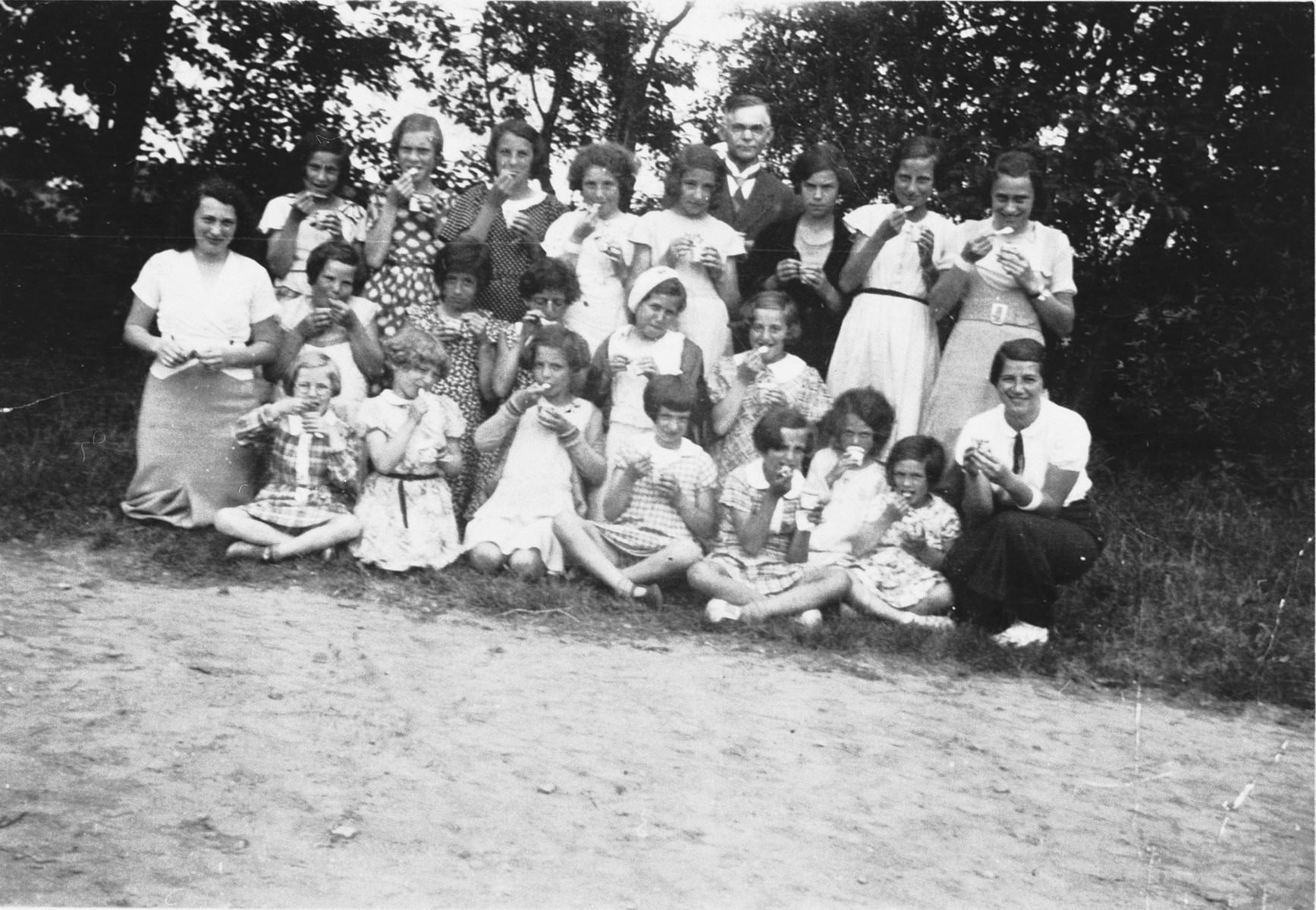 Group portrait of campers and counselors at a Jewish summer camp in Skibstrup, Denmark.  The camp was affiliated with the Karolinenskolen, a Jewish day school in Copenhagen.  Among those pictured is Kaja Diament (front, right), who was a counselor at the camp.