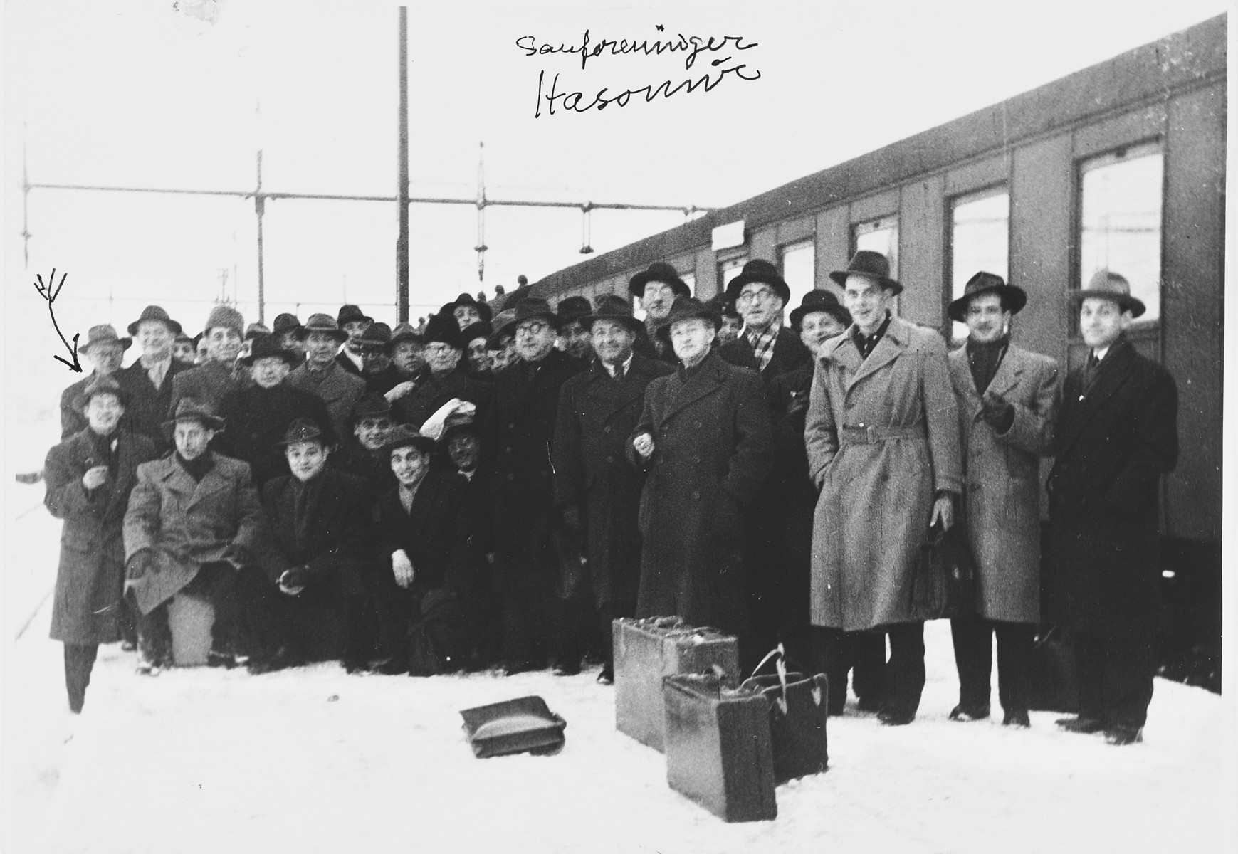 Group portrait of members of the Hasomir Jewish choir at the Hovedbanegarden train station in Copenhagen.  Among those pictured is Bernhard Diament (second from the left).