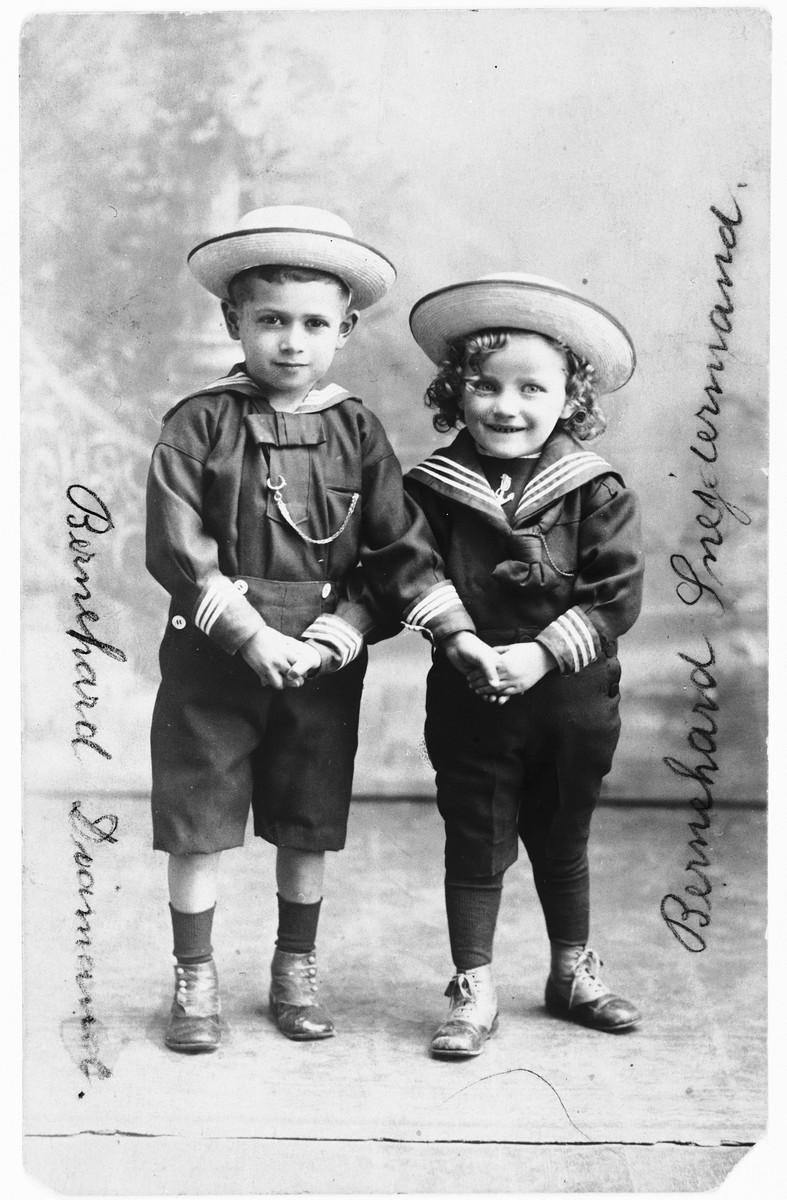 Studio portrait of two young Jewish children in Copenhagen.  Pictured are the cousins Bernhard Diament (left) and Bernhard Schneider Mann (right).