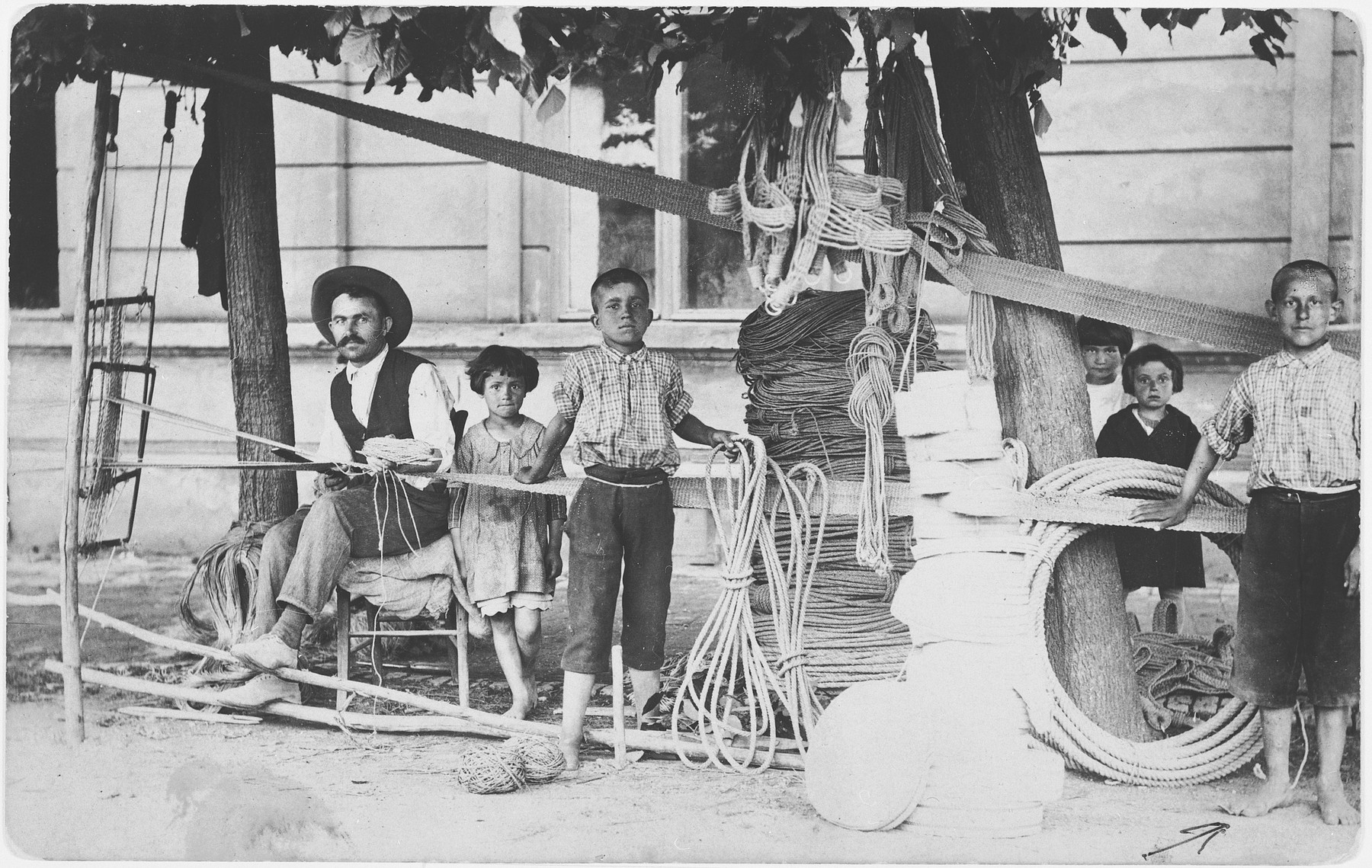 Moshe Lowy apprentices as a rope maker in the workshop of Mikhailo Radosavljevich.