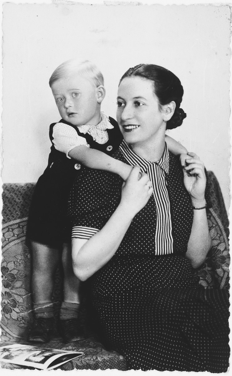 Portrait of a little boy with his mother.   Pictured are Leszek, who perished in Auschwitz in 1943, and his mother, Helen Israel, who survived the war.
