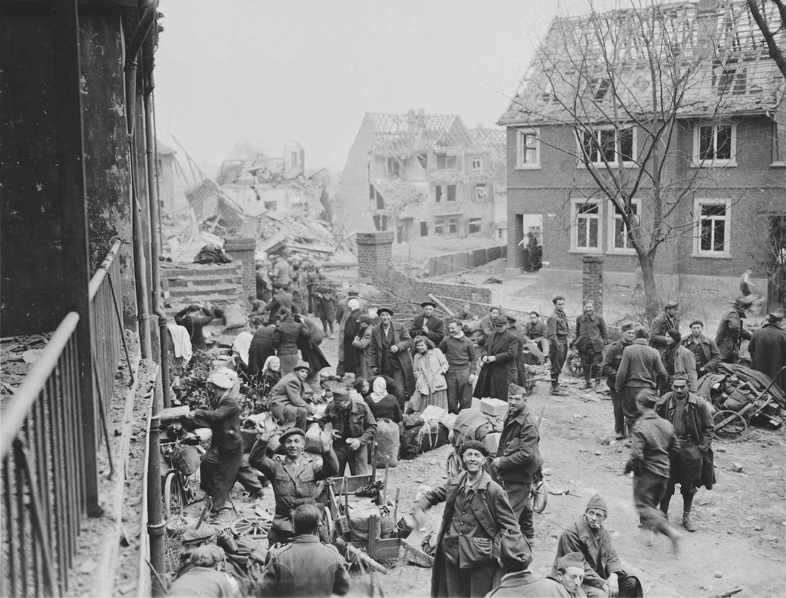 Slave laborers in the town of Altenkirchen, who were liberated by the U.S. First Army, collect their belongings and await evacuation to a nearby area.